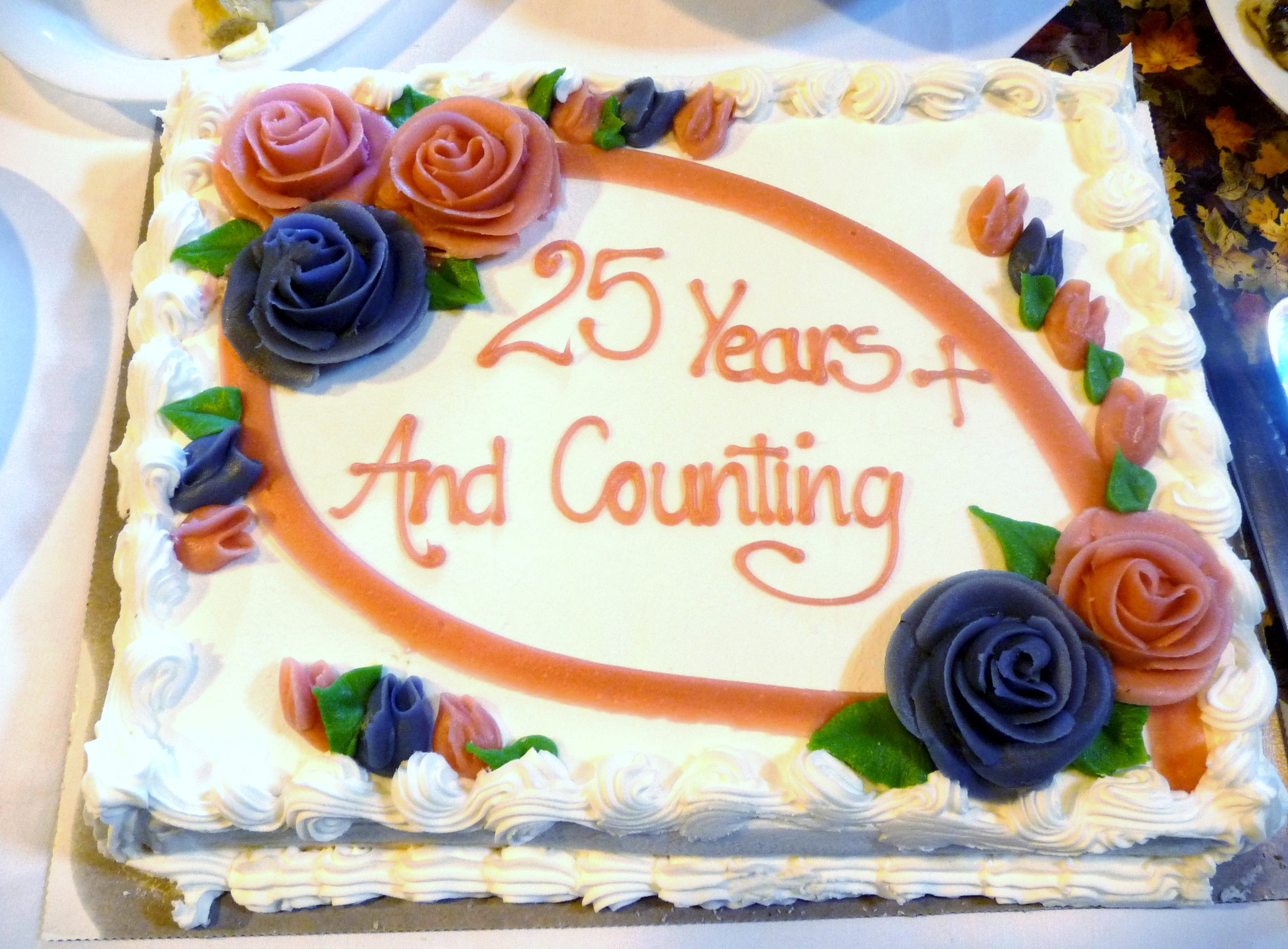 at our  September Tea Party 2014 we had a celebration cake especially for all our members who had been with MEG for 25 years or more