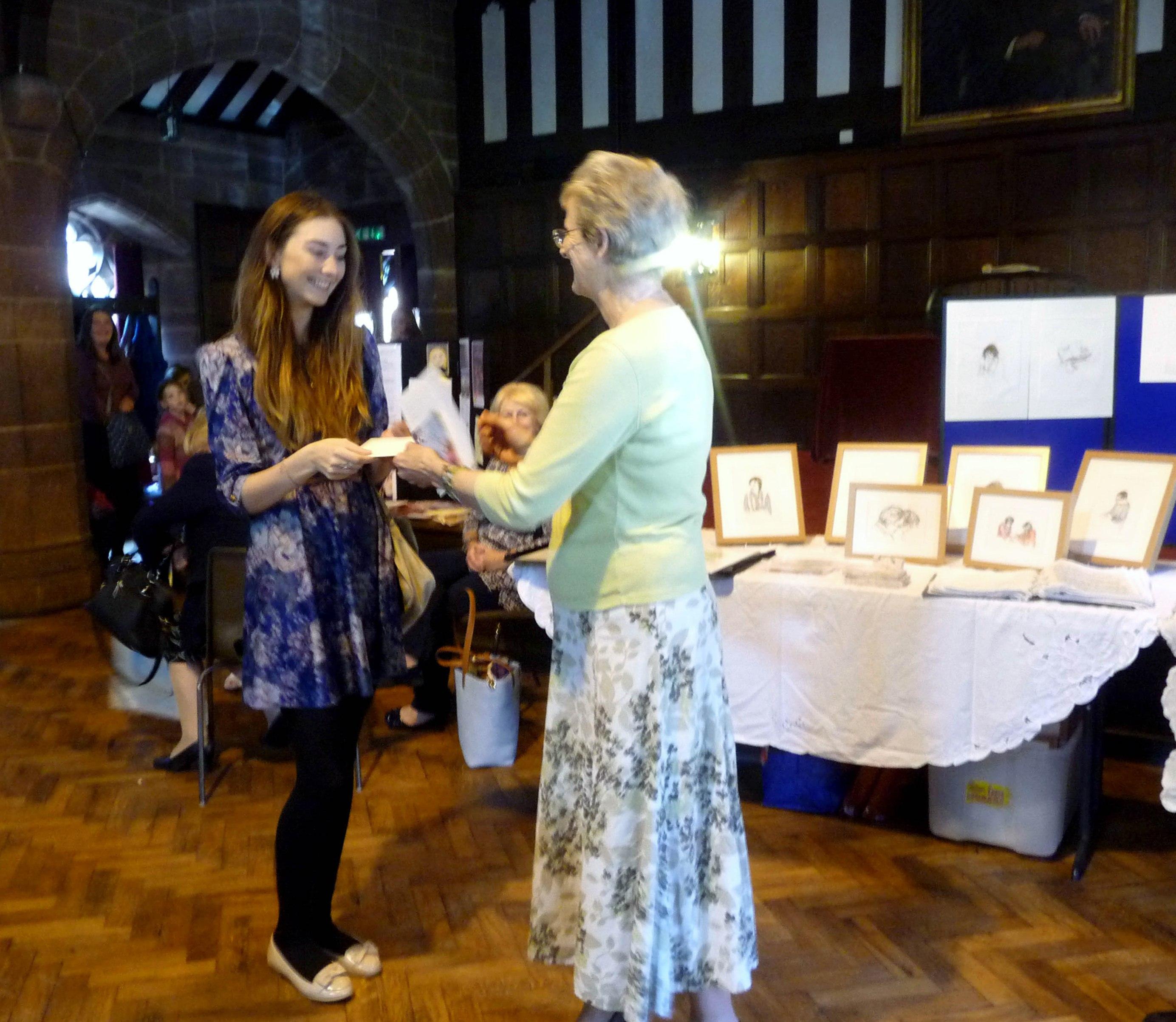 2014 Bursary winner Judith Kemp receiving her cheque from MEG Chair Kim Parkman