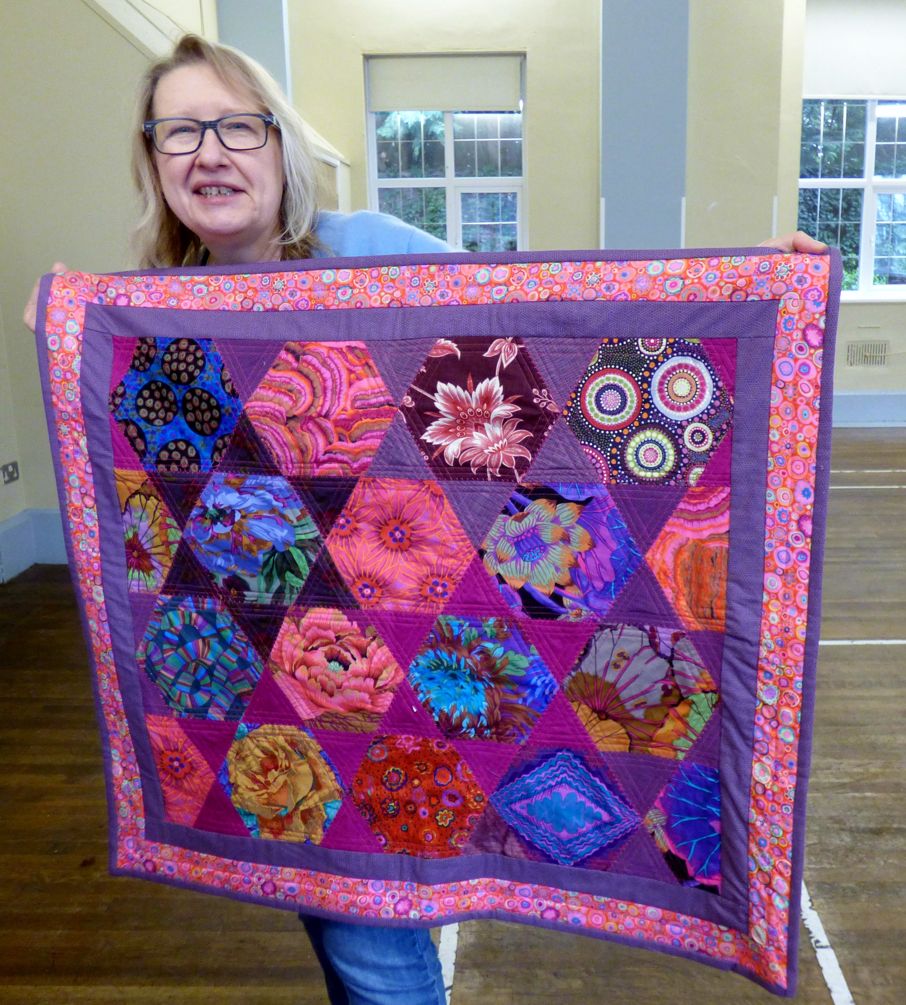 cushion cover by Gill Roberts. Thiis quilt was made from off cuts from the Kaffe Fassett workshop