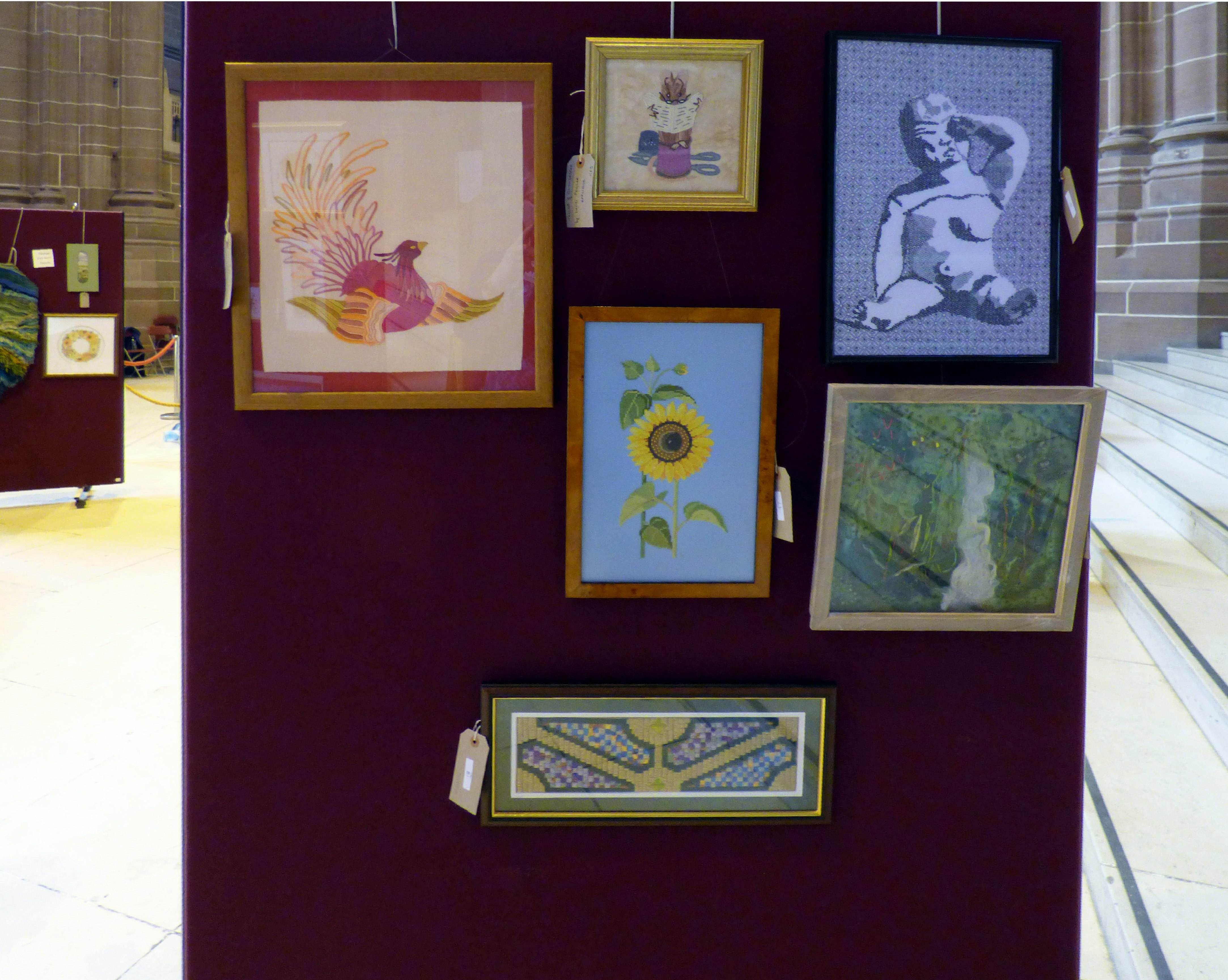 OUT OF THE ASHES by Ann Thyer, TAILOR OF GLOUCESTER by David Peglar, STONE BABY by Hilary McCormack, CAPABILITY BROWN by David Peglar, GIRASOLE by Ann Thyer and RAINFOREST, COSTA RICA by Linda sowler at 60 Glorious Years exhibition 2016