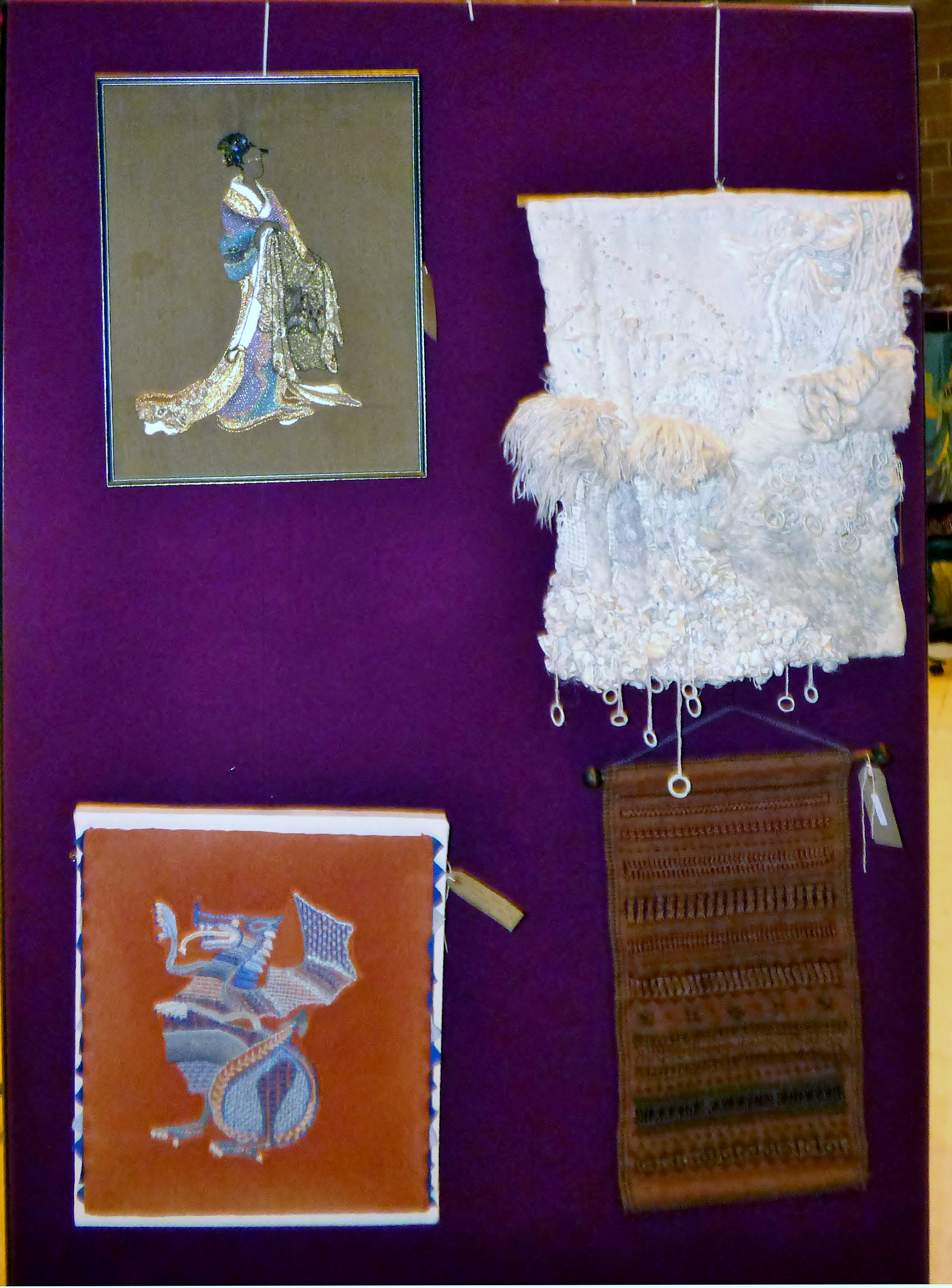 AFTER UNTAMARO by June Hodgkiss, SNOW STORM by Rubina Porter MBE, WELSH DRAGON by Marie stacey and LINEN SAMPLER by dora Carline at 60 Glorious Years exhibition 2016