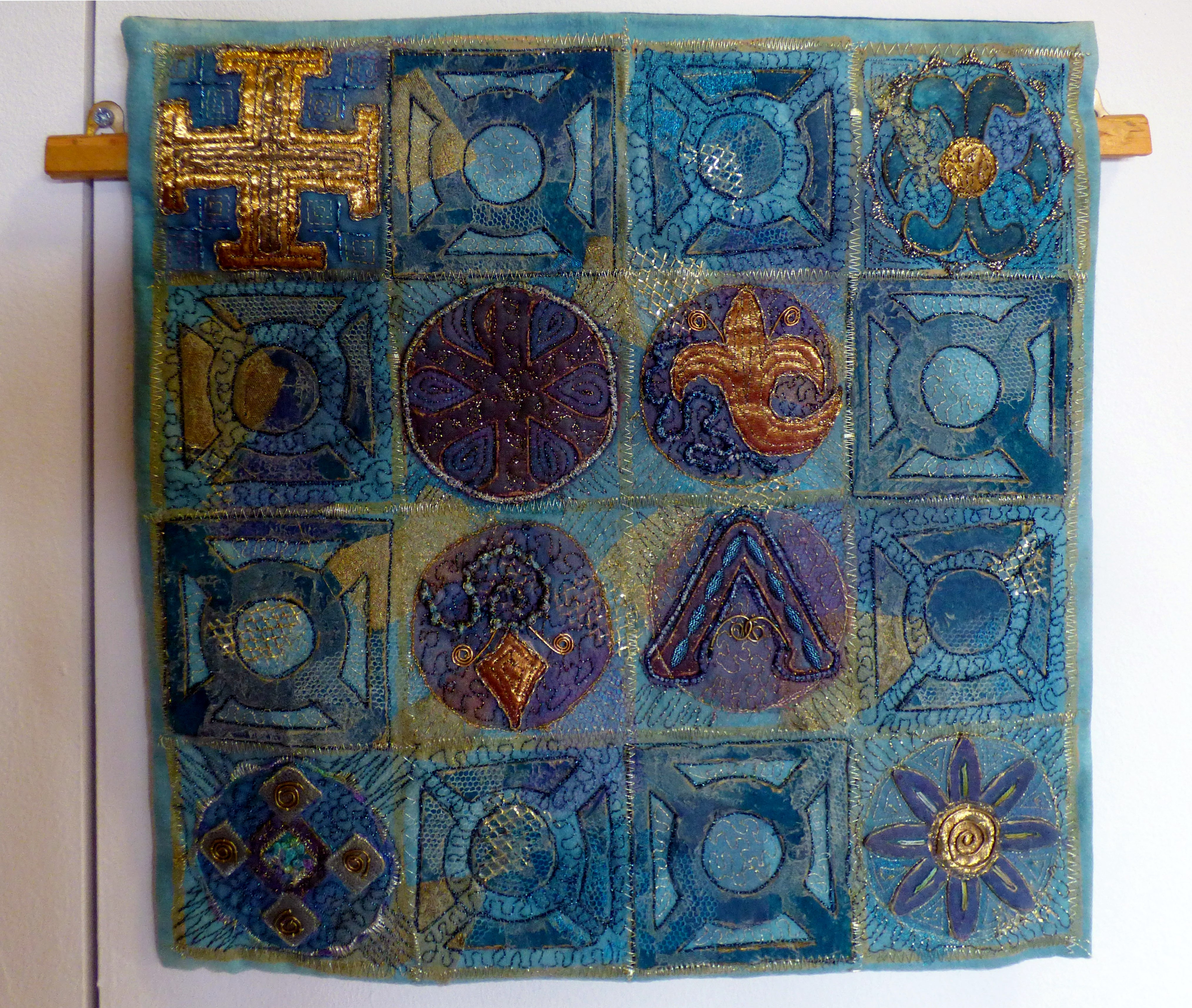GETHSEMANE by Hilary Kimber, pieced & bonded fabrics with machine & hand stitching. Design based on the gates of the Church of All Nations, Jerusalem