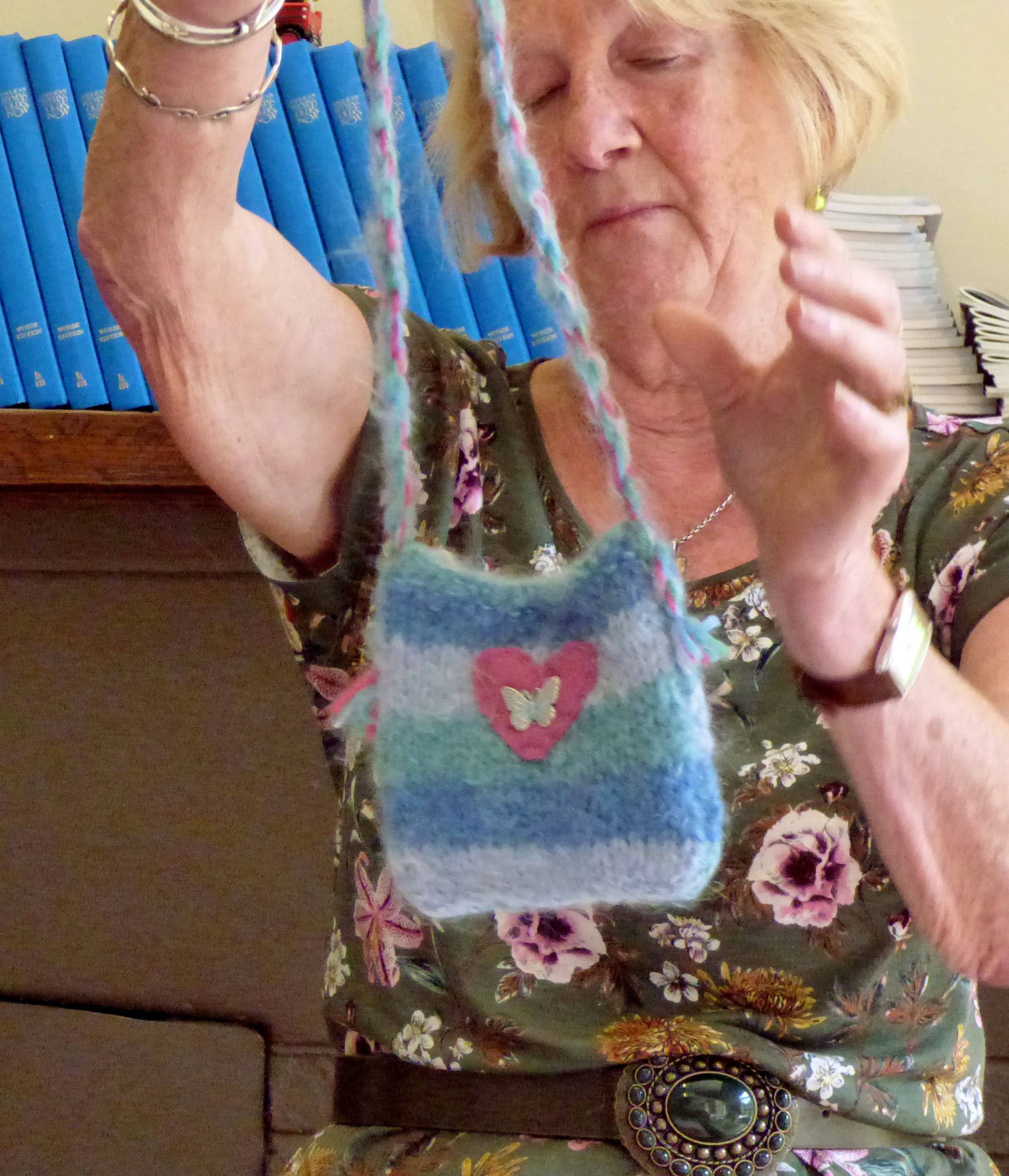 Chris Harris with knitted bag made by children from Kettleshulme C of E school, Derbyshire