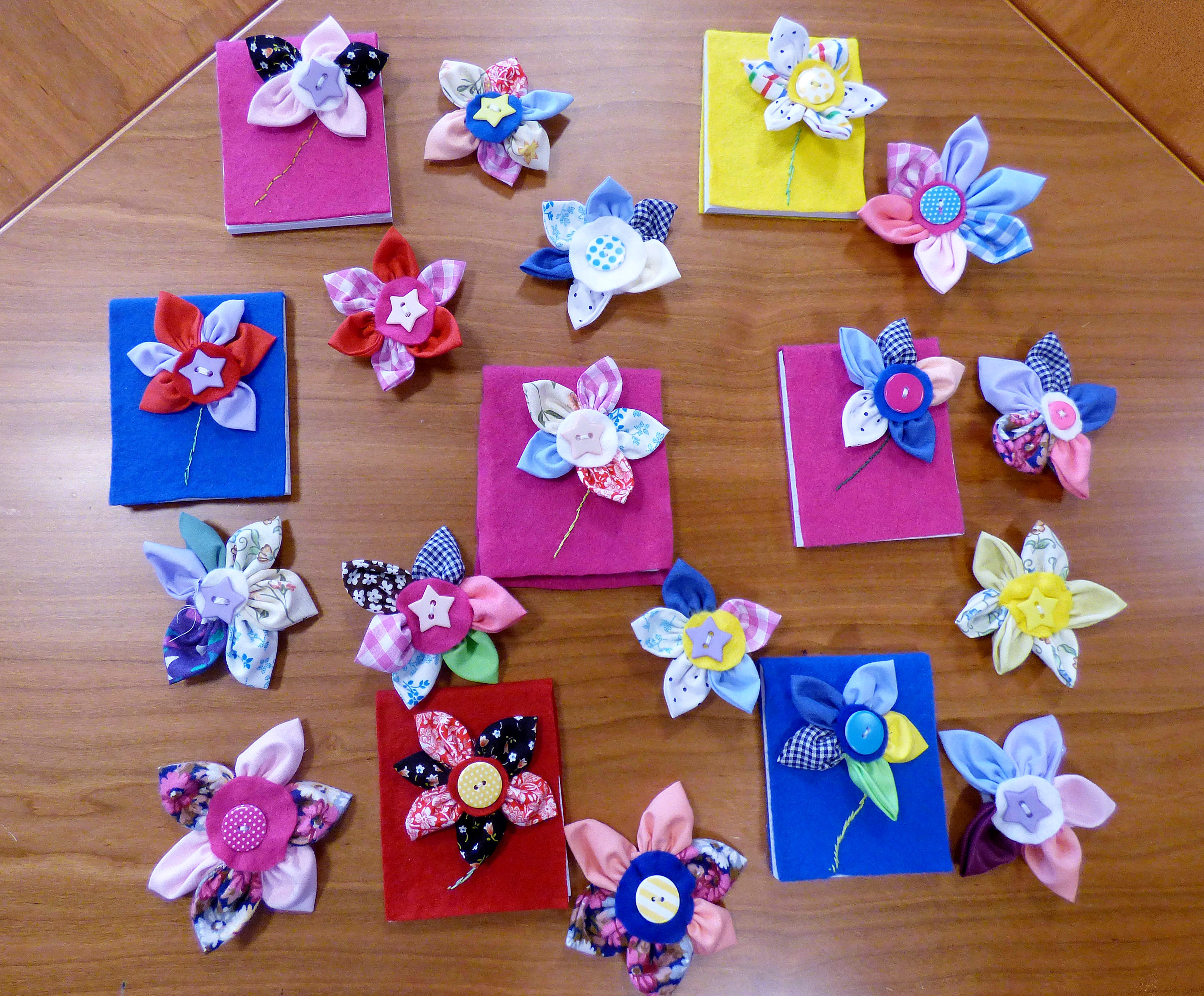 we made notebooks, hair slides and flower badges in YE Group, July 2016
