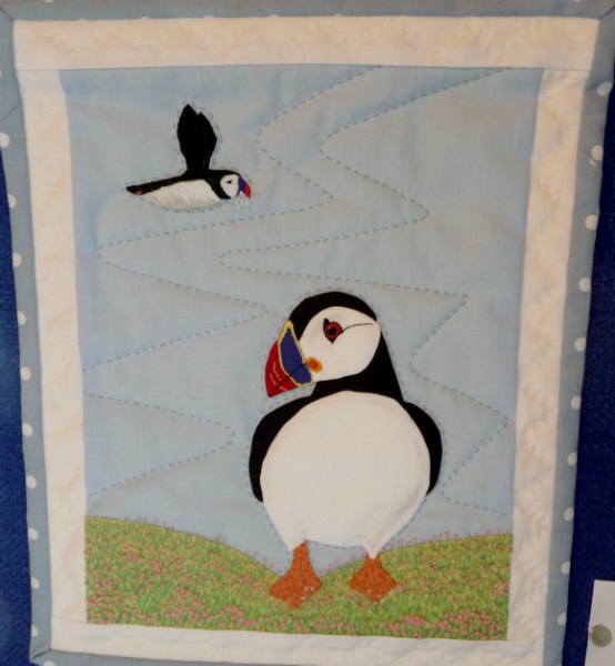 PUFFIN WALLHANGING by Lesley Tarnowski, hand embroidery on hand applique and hand quilting
