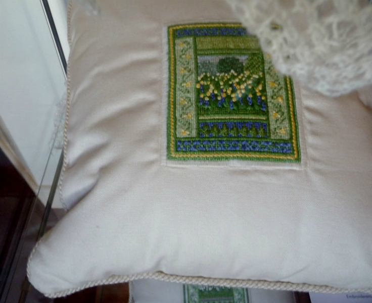 CUSHION 1 by Mary Holder, cushion with a panel of a garden in a variety of stitches