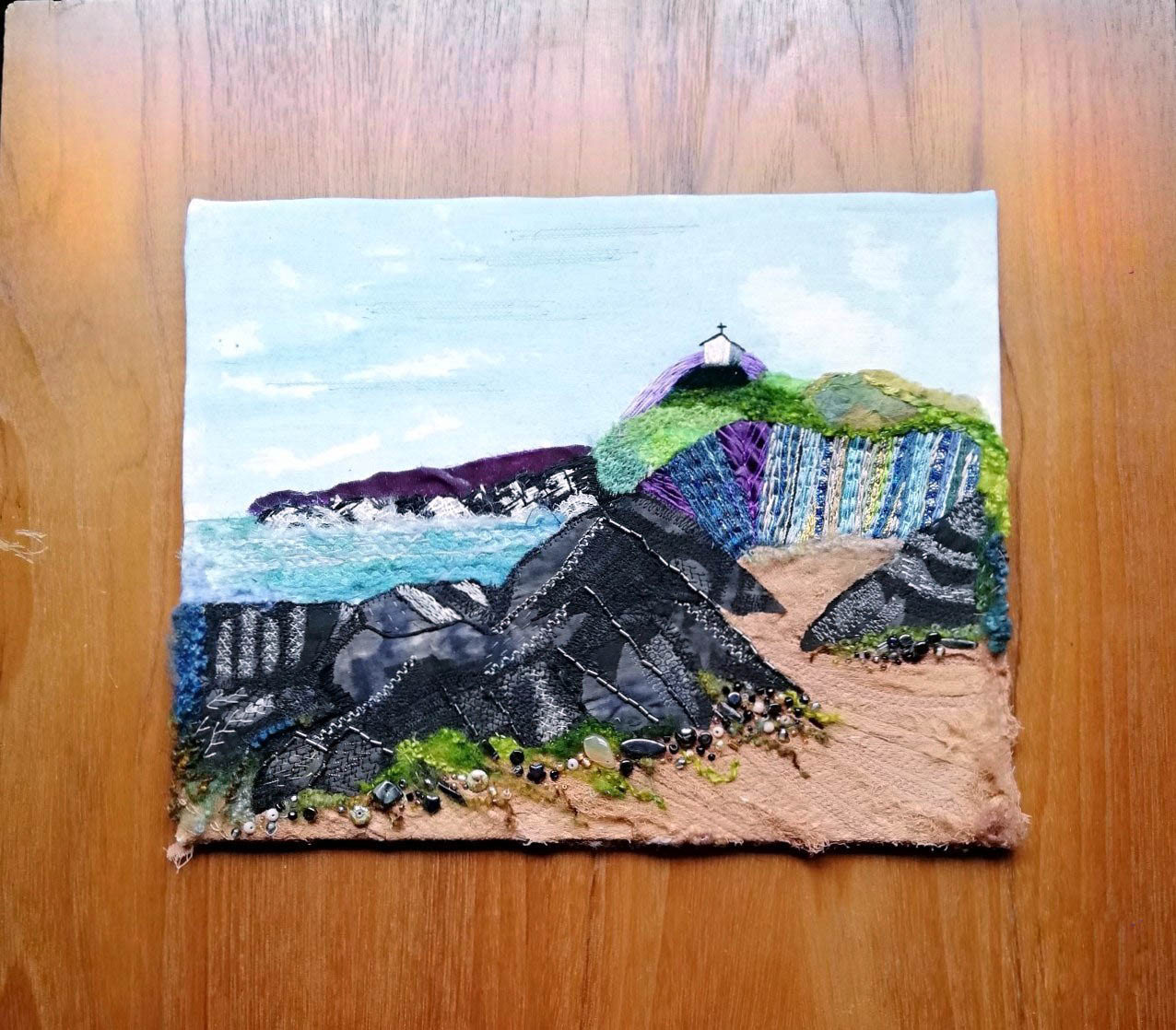ST NICHOLAS CHAPEL, ILFRACOMBE by Carole Hawthorne, Bolton branch, hand painted background with hand stitch, machine embroidery and mixed media, Aurifil competition 2021