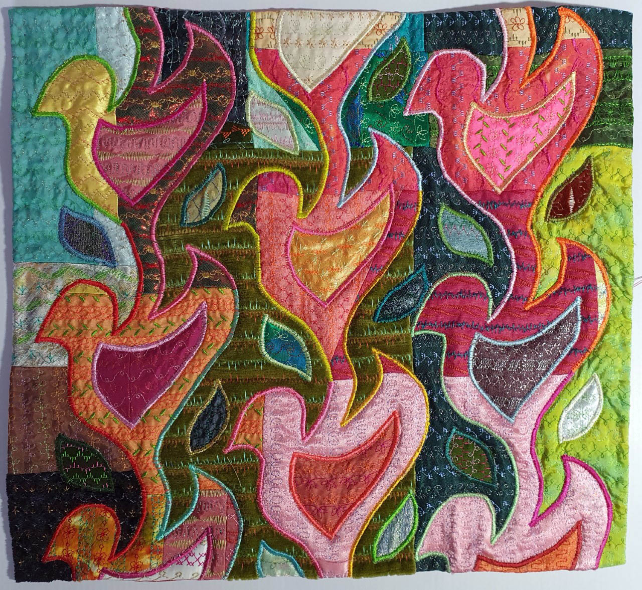 BIRDS IN THE RAINFORSET by Jane Rylands, Cheshie Borders branch, machine embroidery, reverse applique and quilting, Aurifil Competition 2021