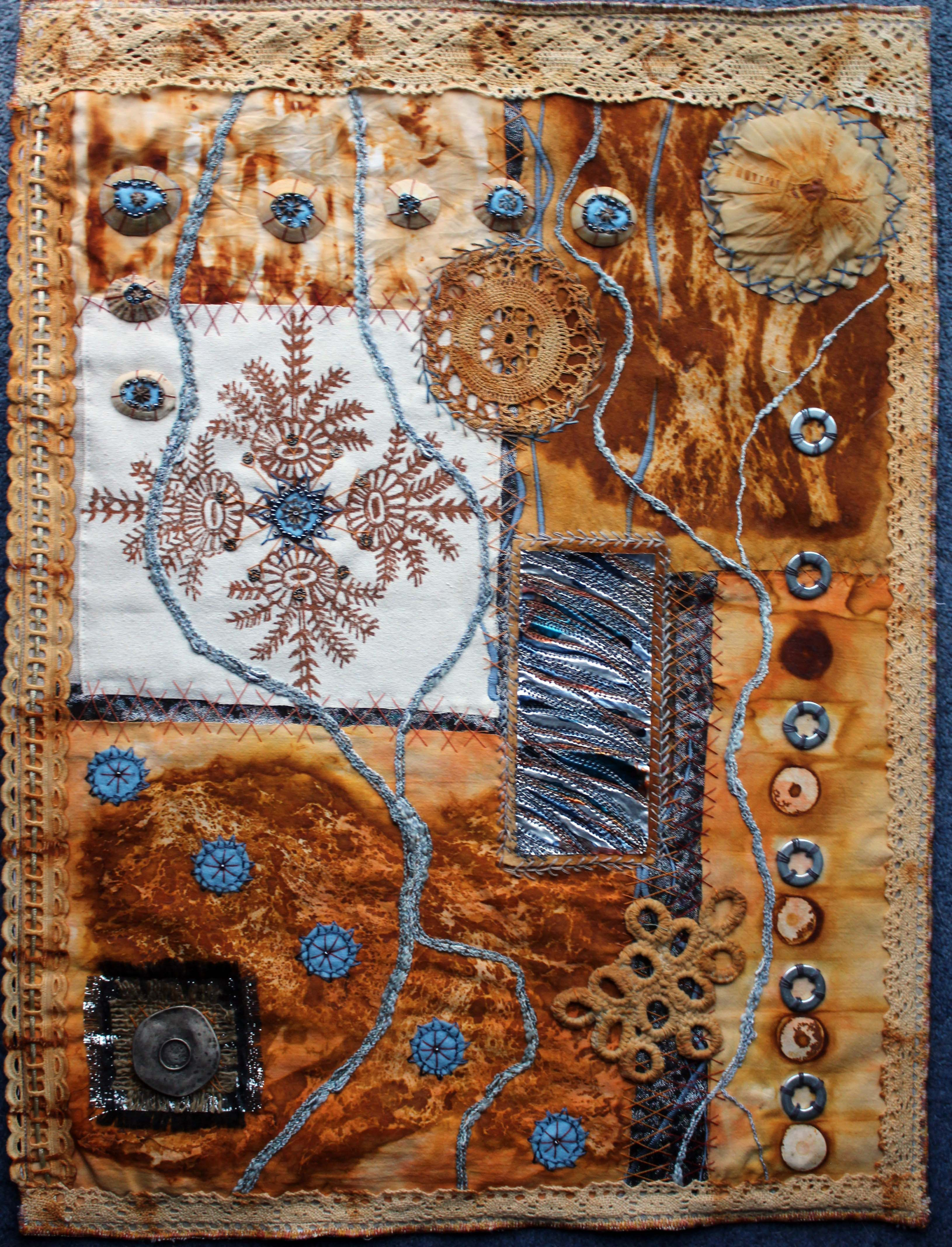 RUST 1 by Sandra Kendal, North Lonsdale branch, rust dyed fabric embellished with hand and machine embroidery