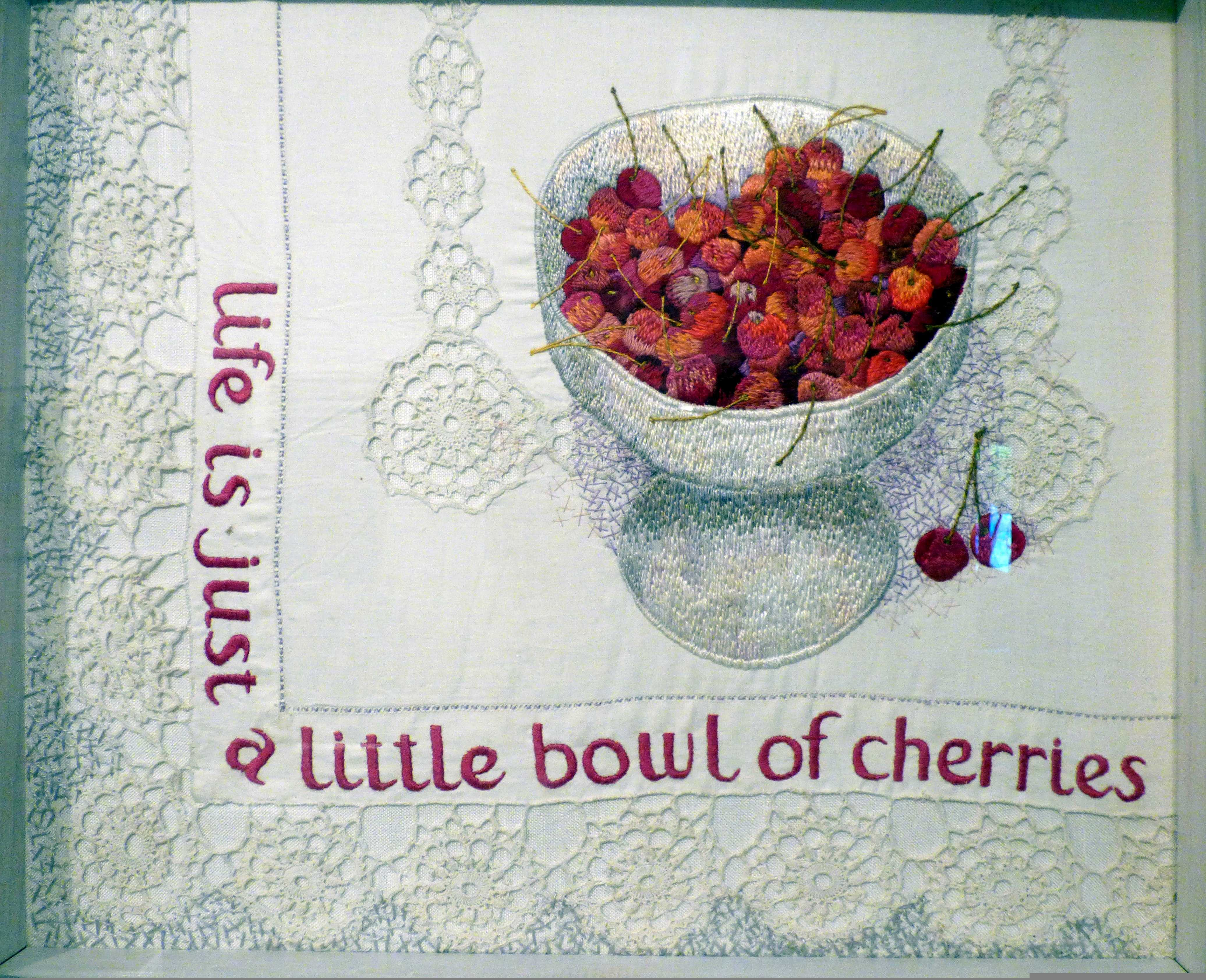 LIFE IS JUST A LITTLE BOWL OF CHERRIES by Audrey Walker, stitched textile, 1984