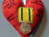 TERRITORIAL WAR MEDAL 1914-19 by Helen Livesey, in memory of all who were awarded, 100 Hearts exhibition, Liverpool Cathedral, Sept 2018