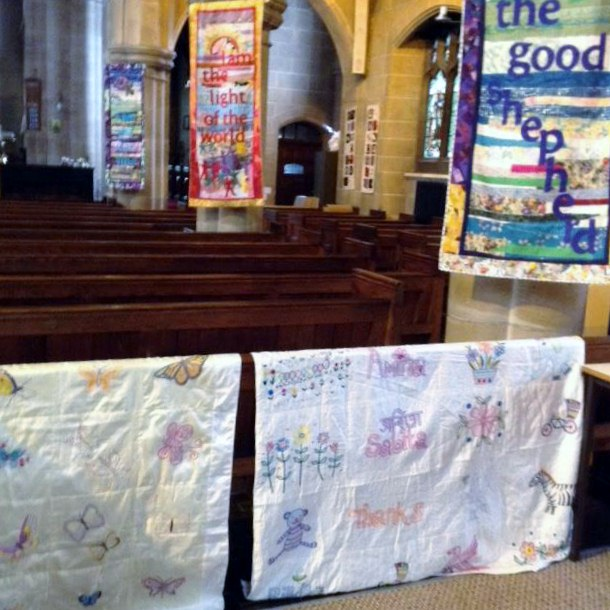 Sreepur Quilts in St Barnabus Church, Oct 2018. The small banners were designed by Norma Heron and created by the ladies of the Parish