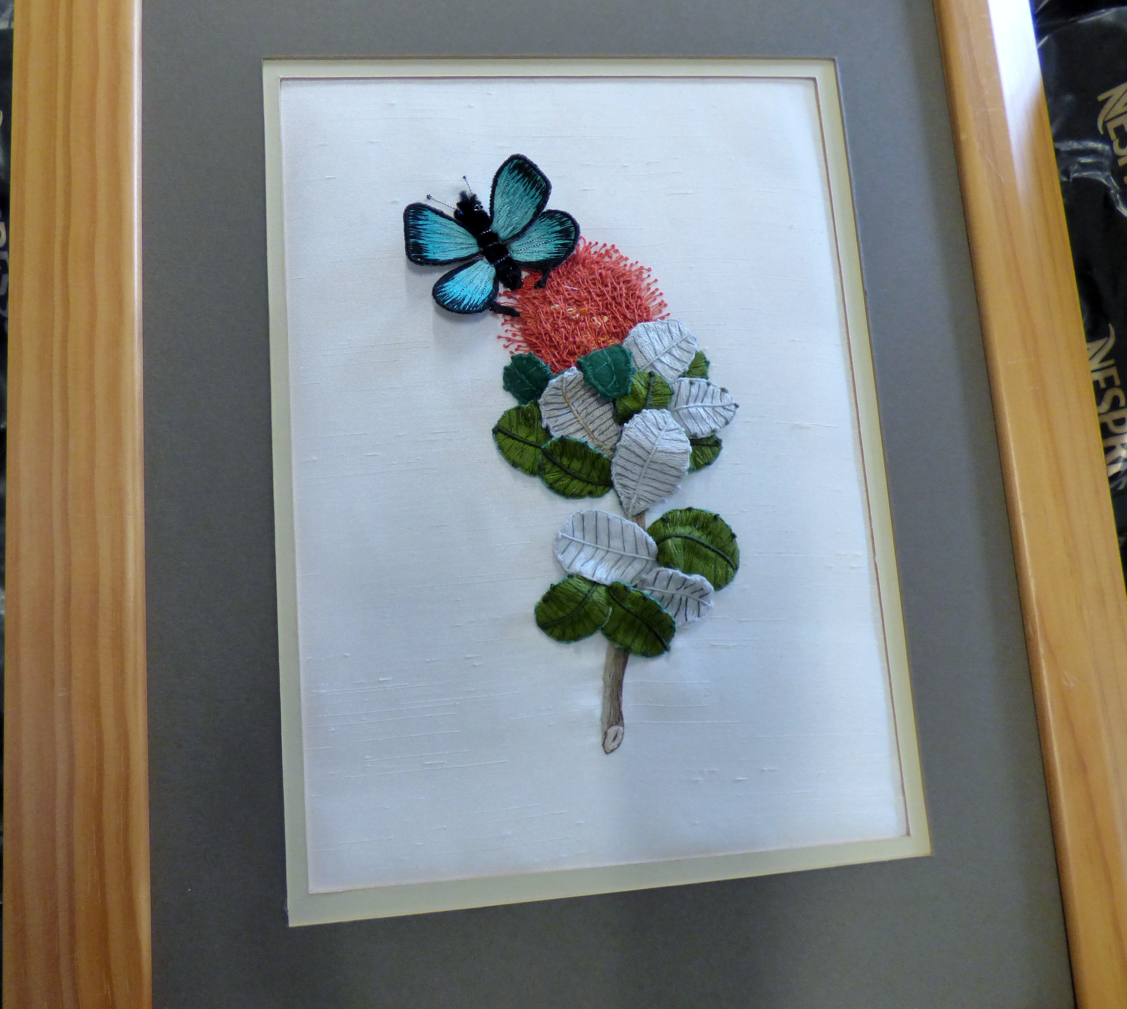 BANKSIA COCCINEA WITH AN AUSTRALIAN ULYSSES BUTTERFLY, stumpwork embroidery by Beryl Webster for our forthcoming ENDEAVOUR exhibition 2018