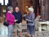 Rubina Porter MBE is talking with Dame Sarah Storey's parents at Threading Dreams exhibition, Liverpool Cathedral, July 2018