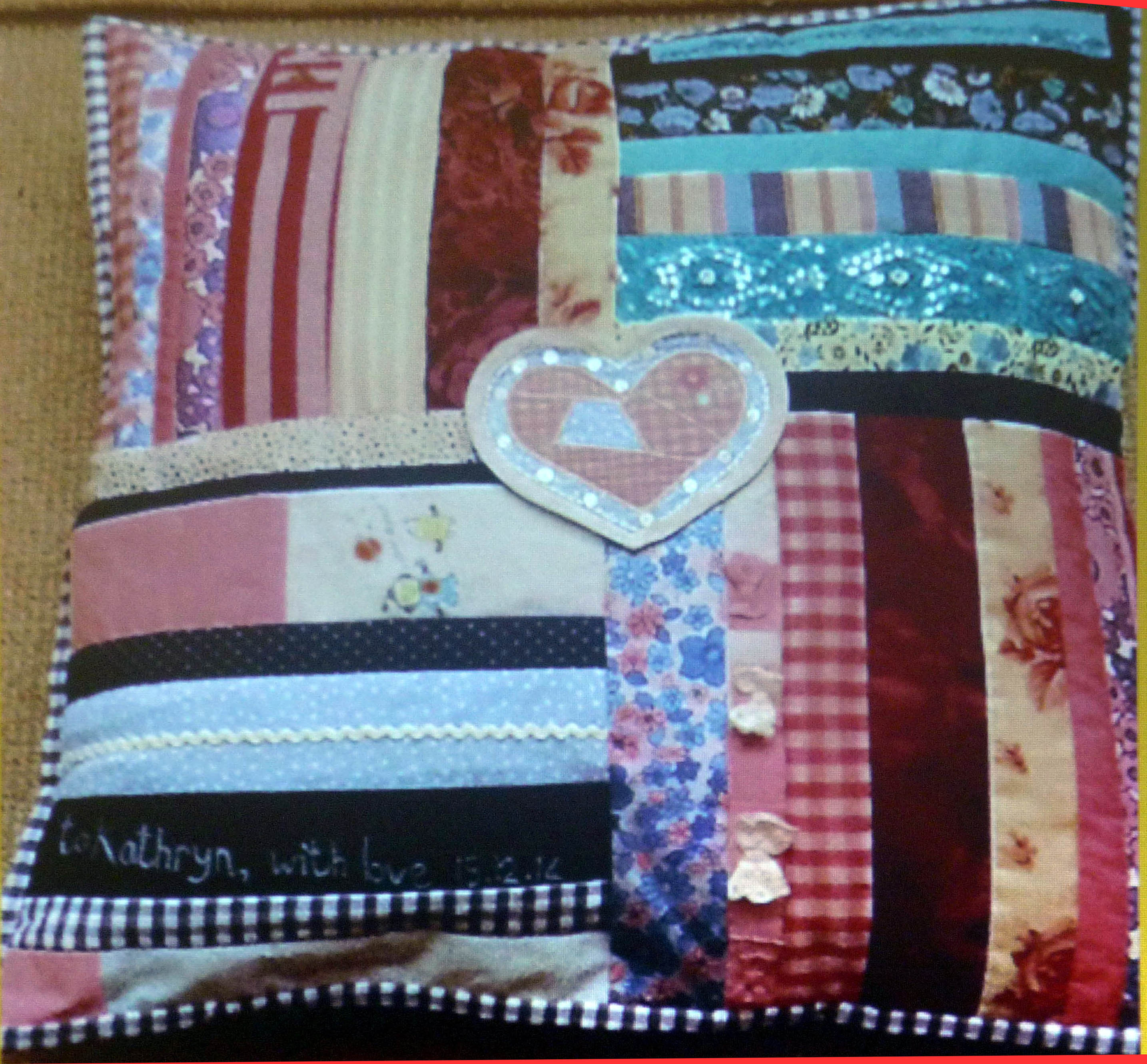 slide showing patchwork cushion by Marie Stacey