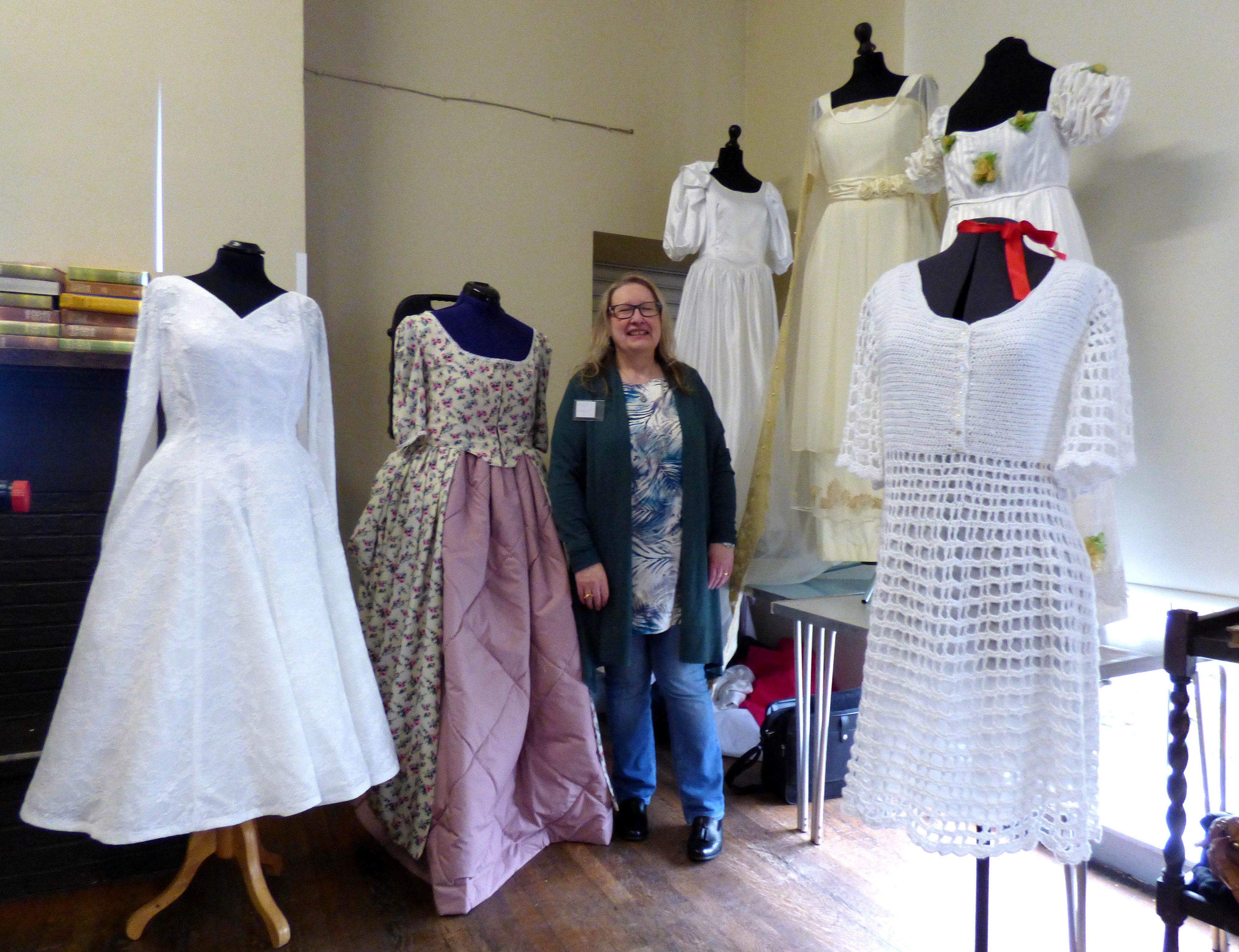"""Gill Roberts surrounded by her fashion history in wedding dresses, at her """"History of the Wedding Dress"""" Talk, MEG 2018"""