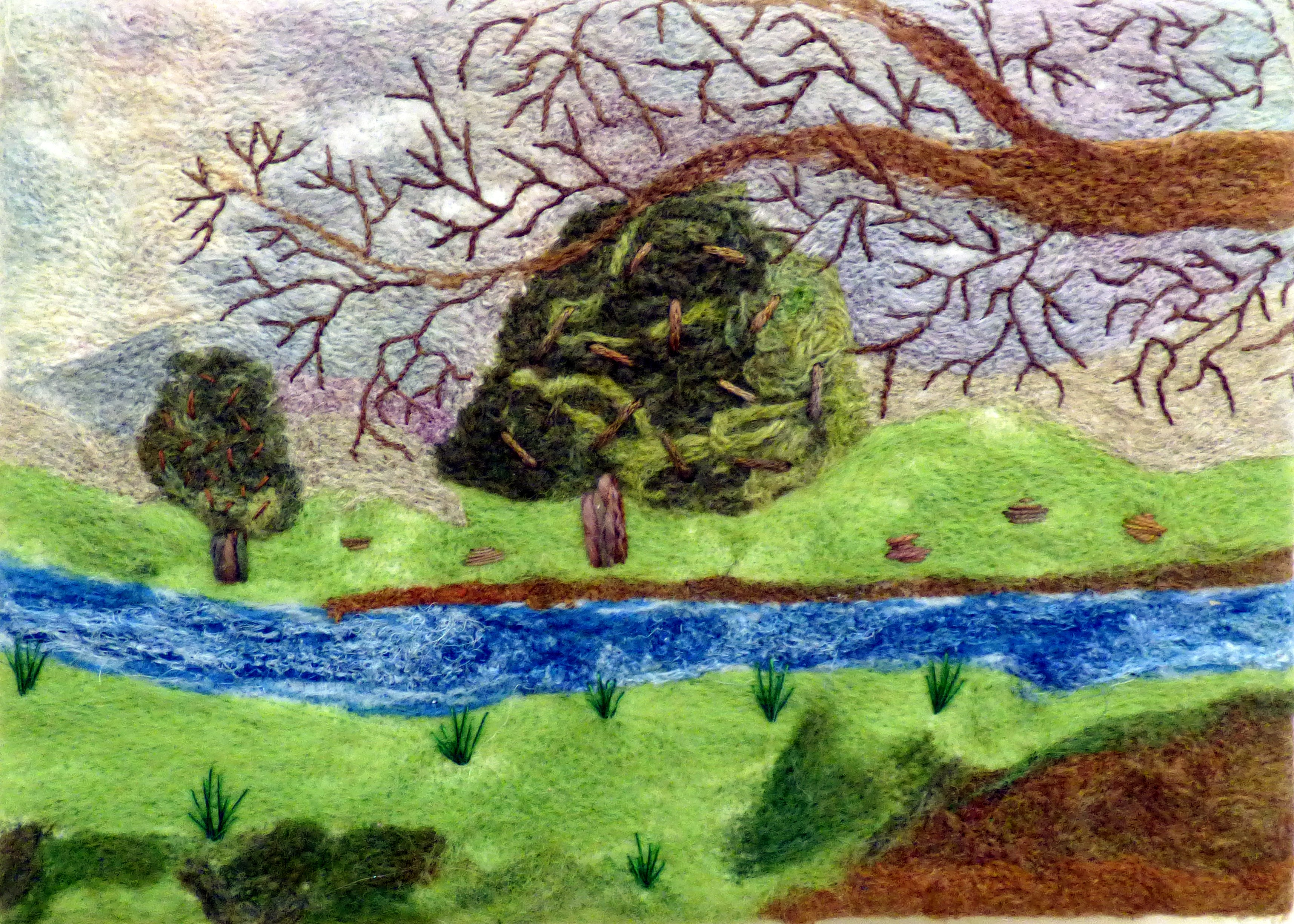 STREAM FLOWING THROUGH WOODLAND by Christine Bardsley, Glossop & District EG, created with and embellisher with added hand embroidery