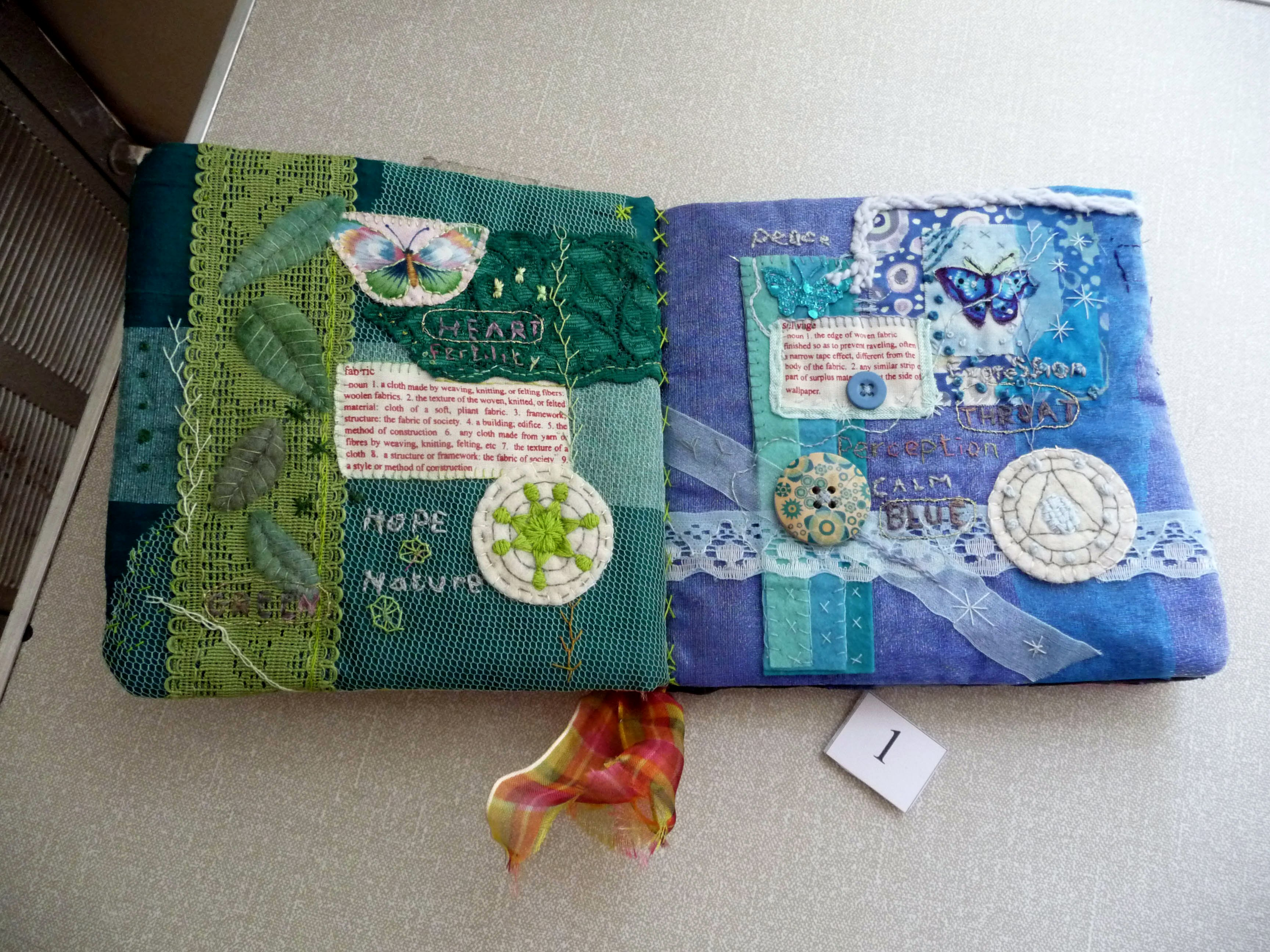 Embroidered book by Mal Ralston, winner of 2014 Colour Competition