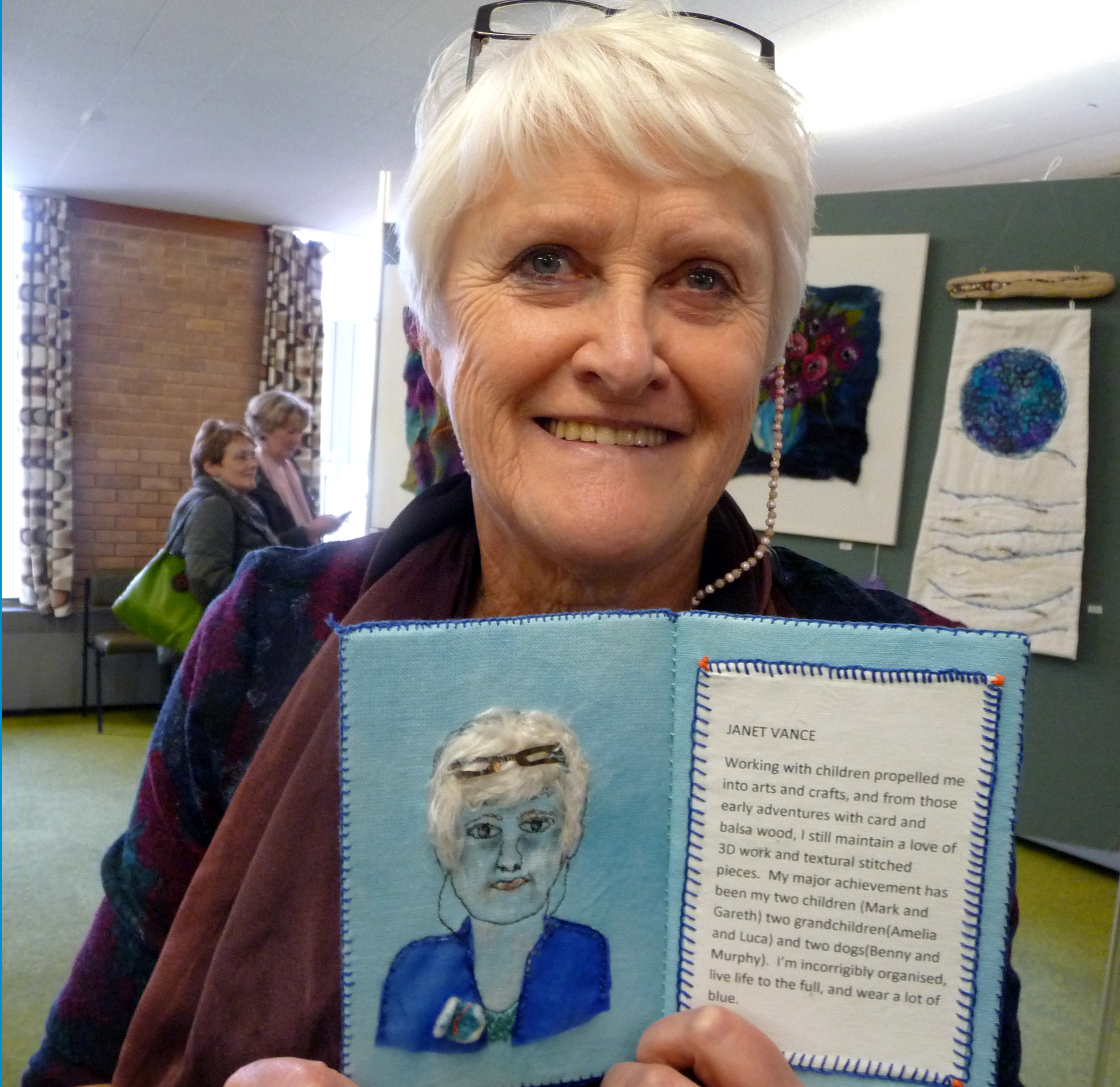 Janet Vance with her embroidered self portrait