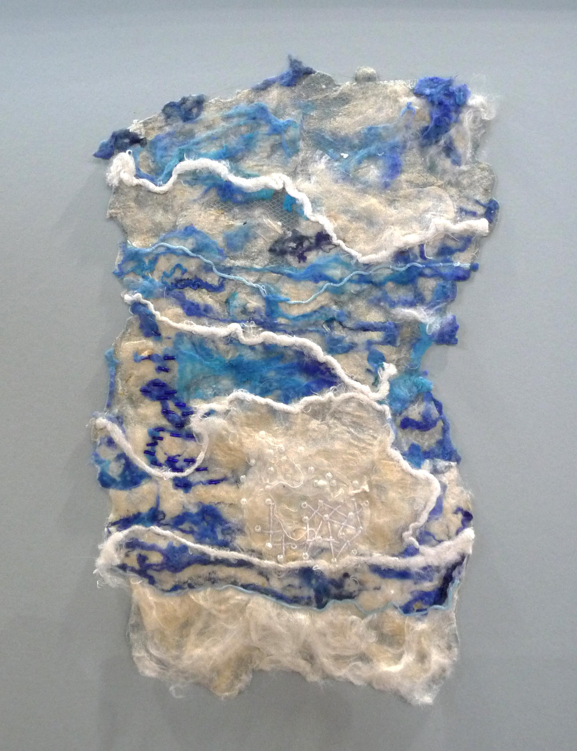 BLUE SKIES WITH WHITE CLOUDS, by Mary Southern, hand and machine embroidered handmade silk paper embellished with pearls