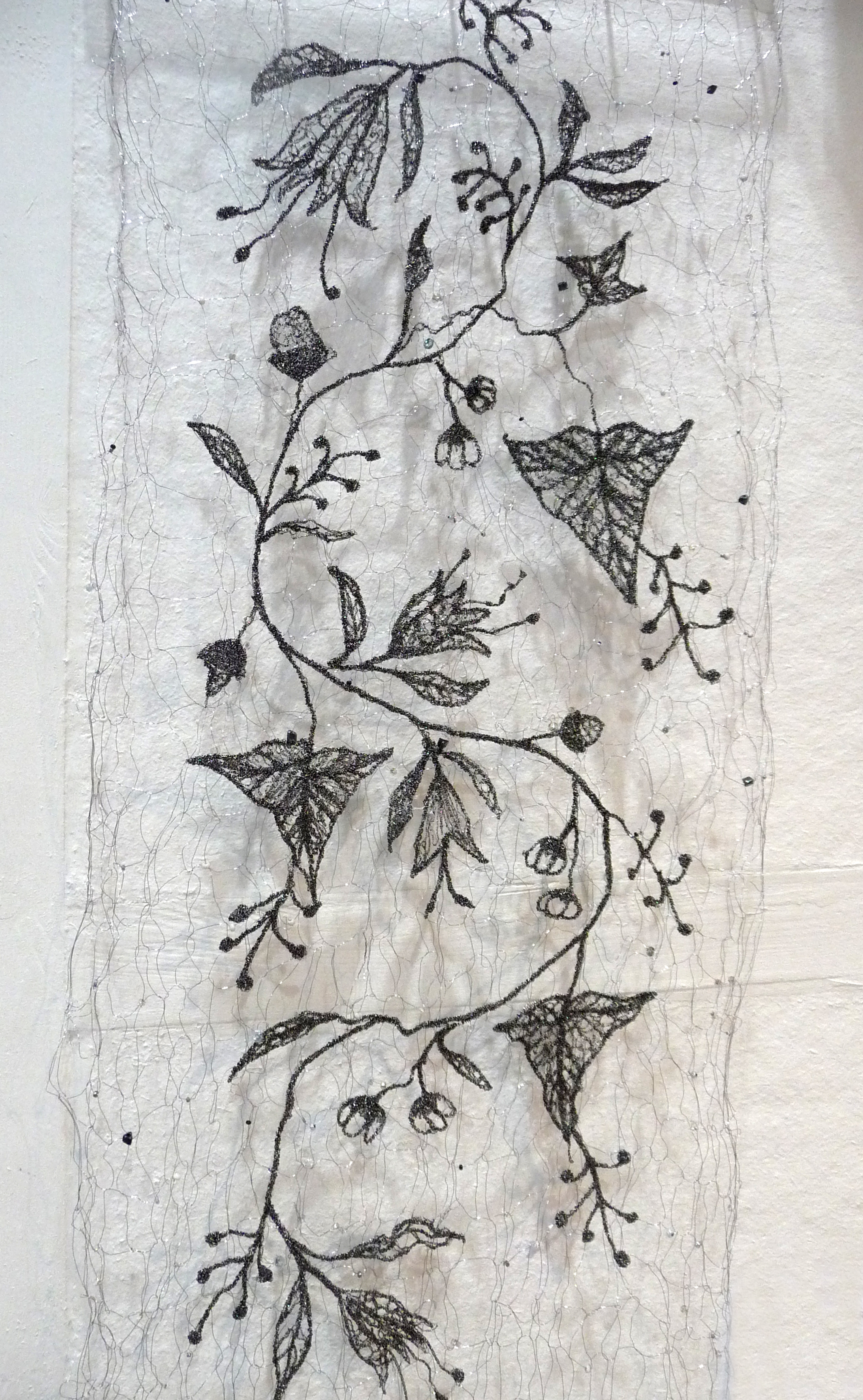 FLOWERS OF PLAS TAN Y BWLCH by Moya McCarthy, free machine embroidery on a beaded knitted wire background