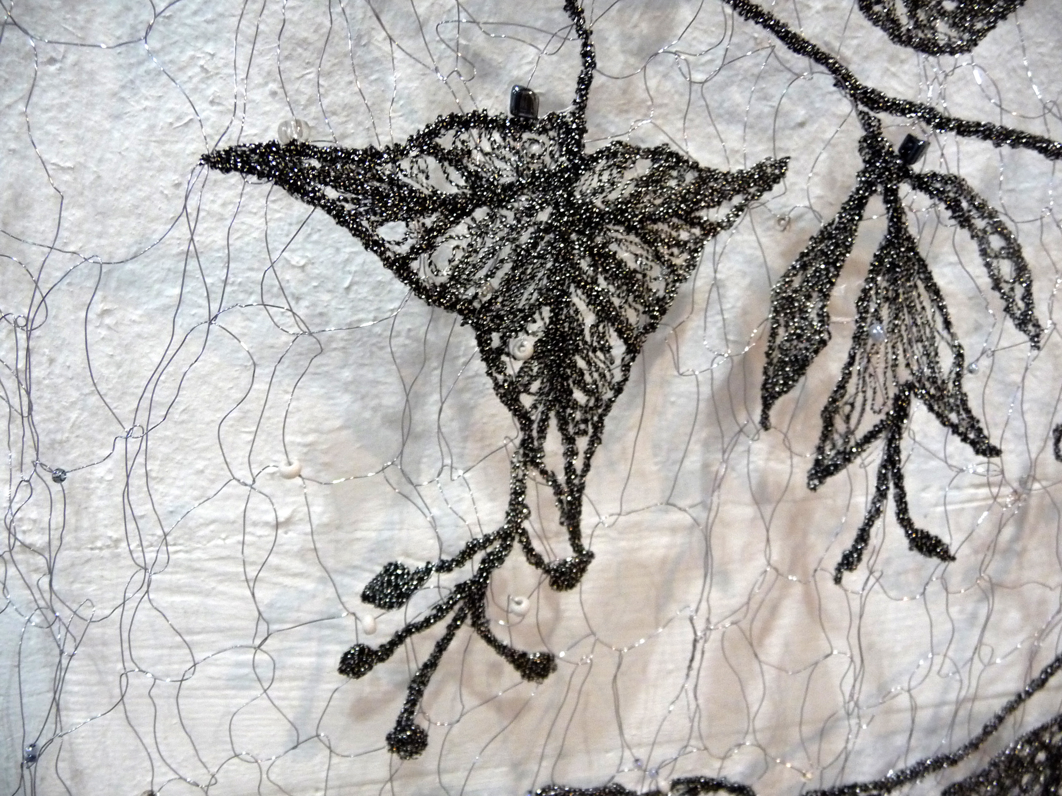 FLOWERS OF PLAS TAN Y BWLCH (detail) by Moya McCarthy, free machine embroidery on a beaded knitted wire background