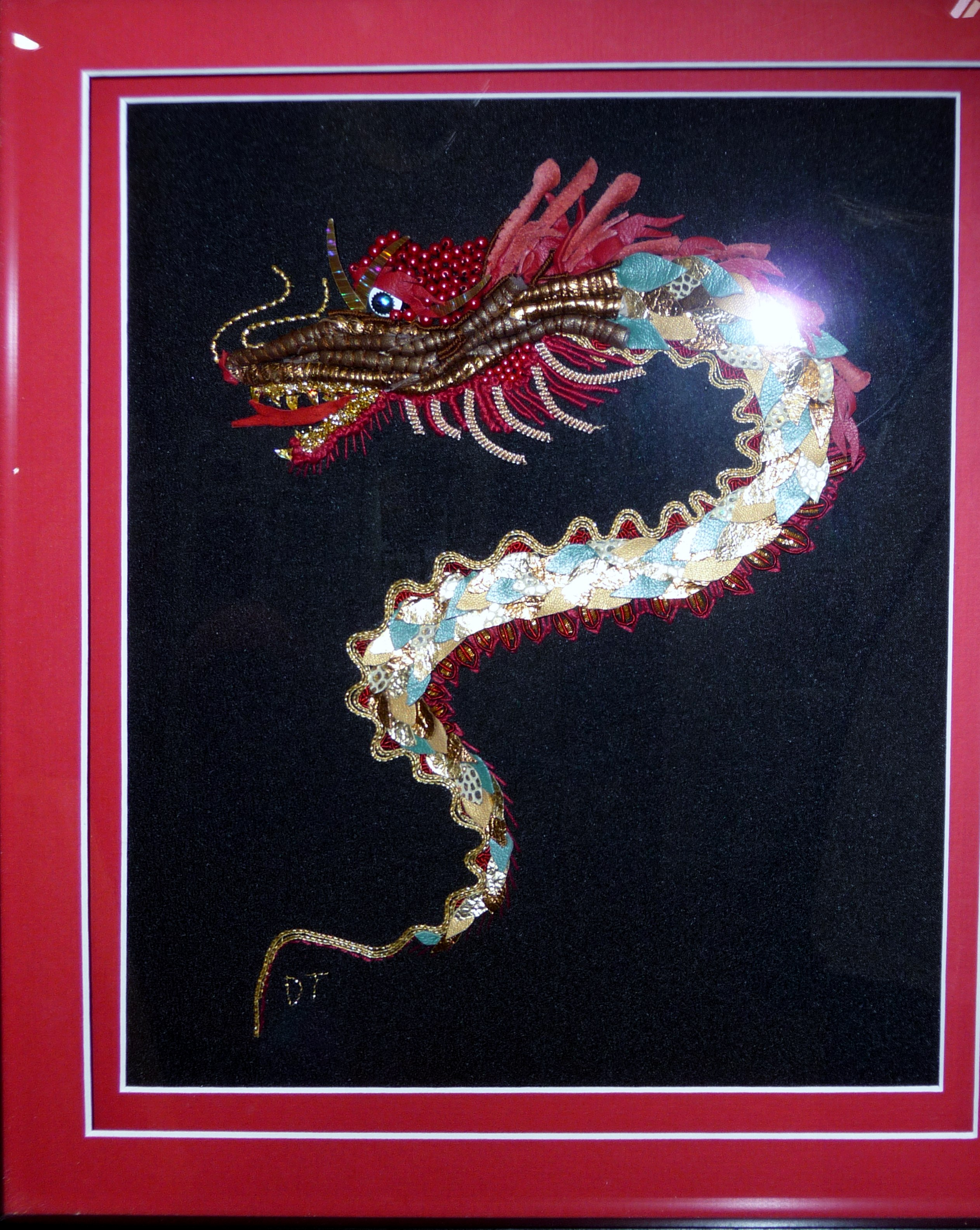DRAGON by Dianne Thomas, goldwork with leather