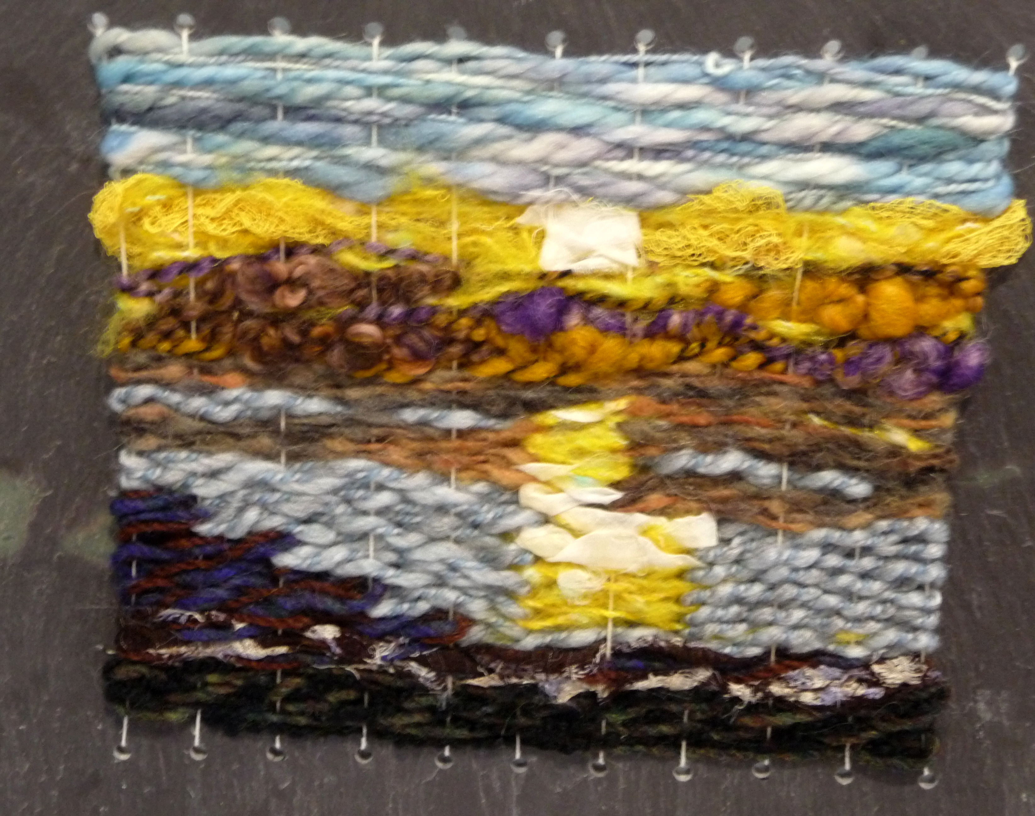 WEAVING 1 by Ronalda White, mixed fibres on slate