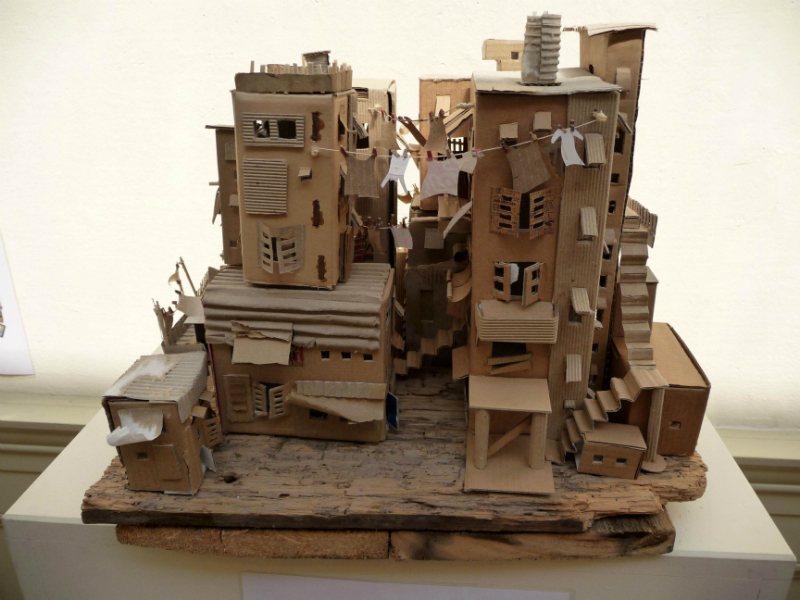 FAVELA by Pamela Sullivan, made from recycled cardboard, flooring and paper. Based on Brazilian housing associated with poorer areas of Rio and San Palo