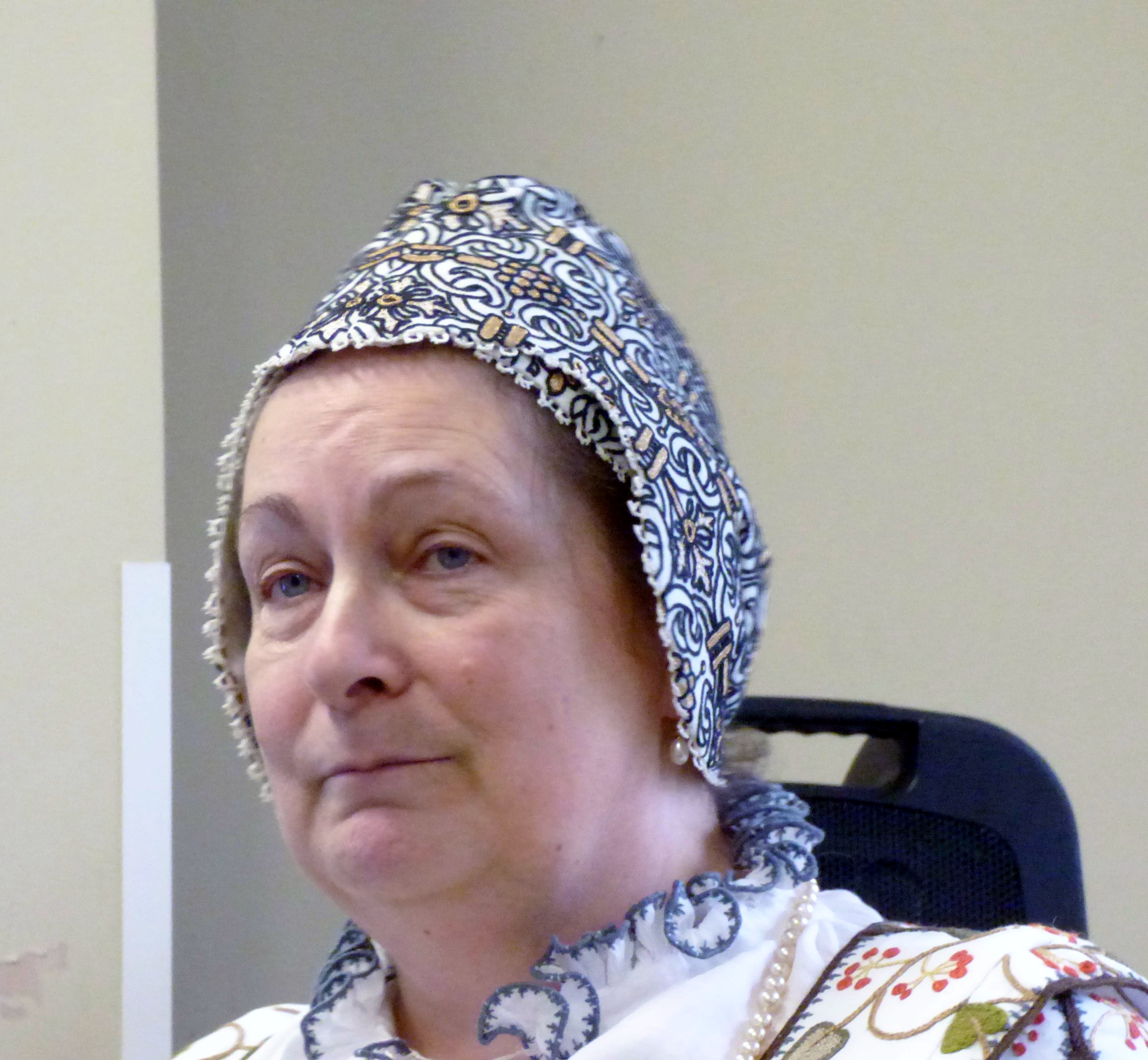 """Carolyn  Richardson wearing a coif and cross cloth, """"Embroidery of a Jacobean Lady"""" Talk by Caroline Richardson, Jan 2019"""