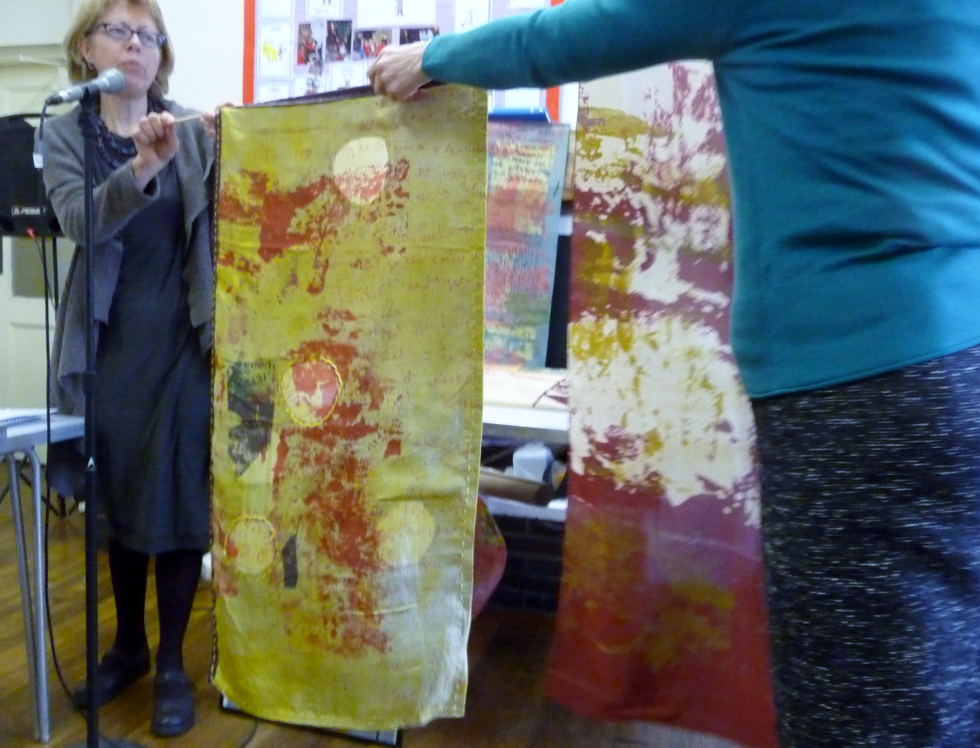 Christine Toh displaying one of her screen printed textiles