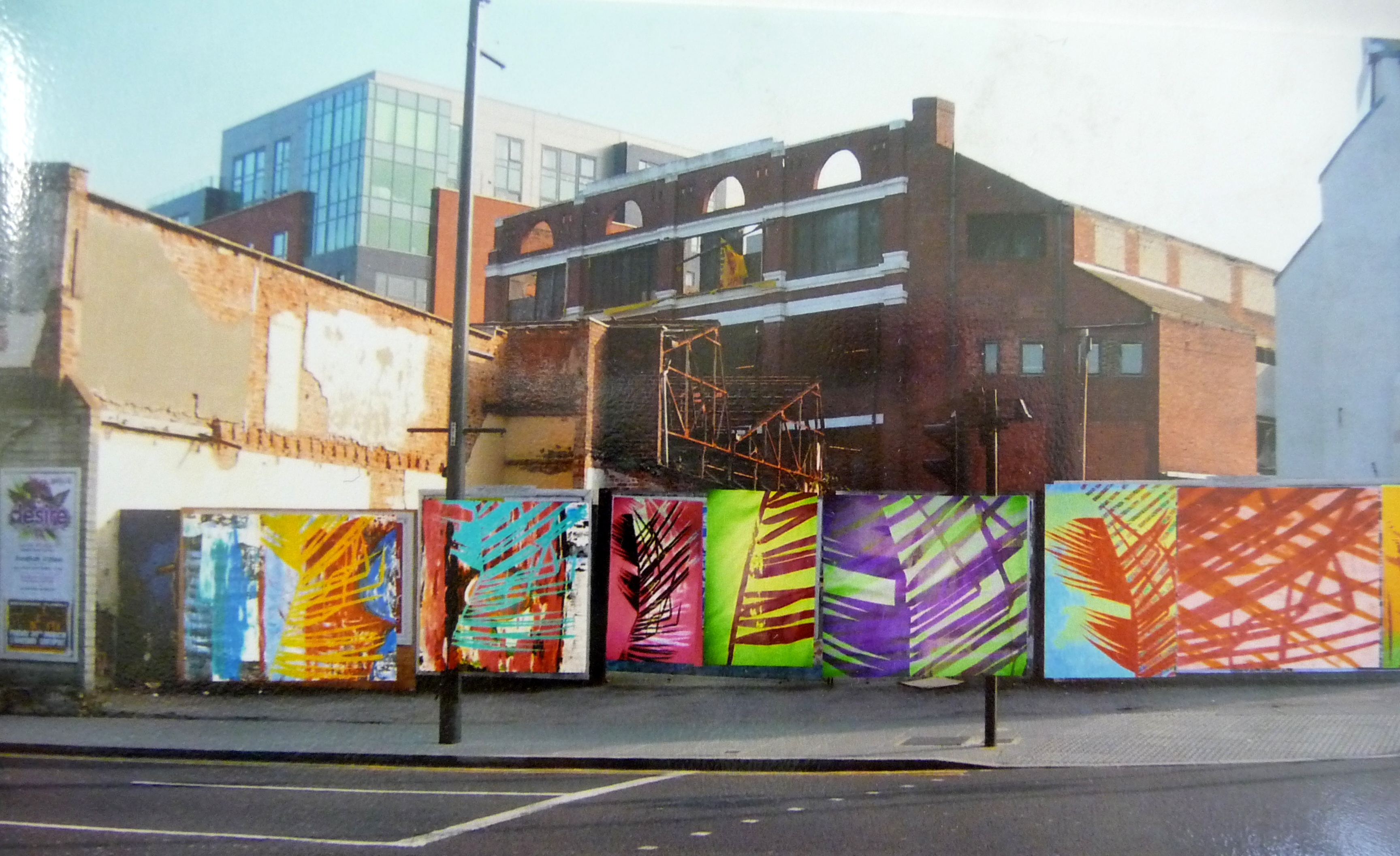 exhibition of screen printed textiles  with a background of urban decay in Liverpool by Christine Toh