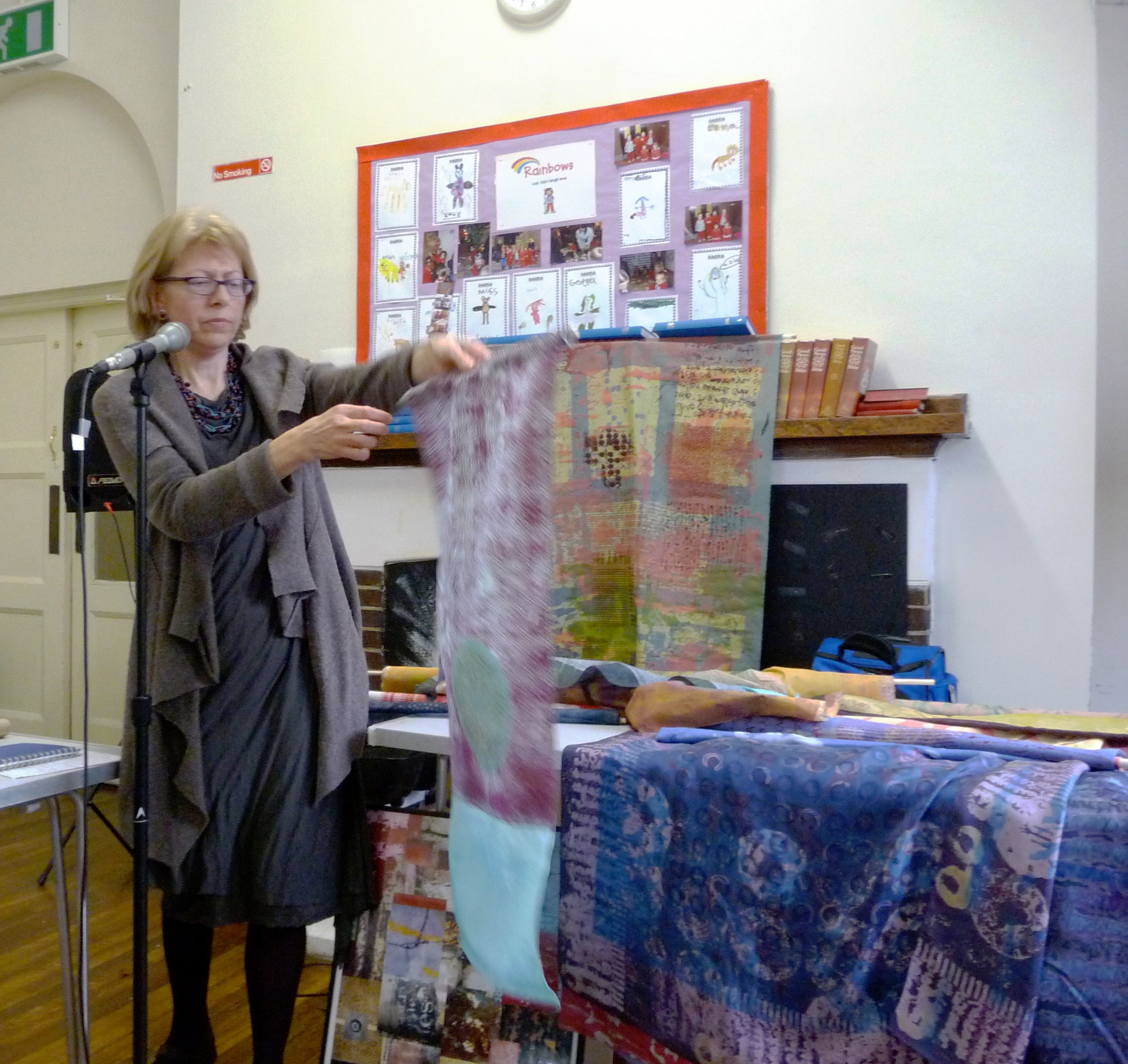 Christine Toh with a display of her textiles