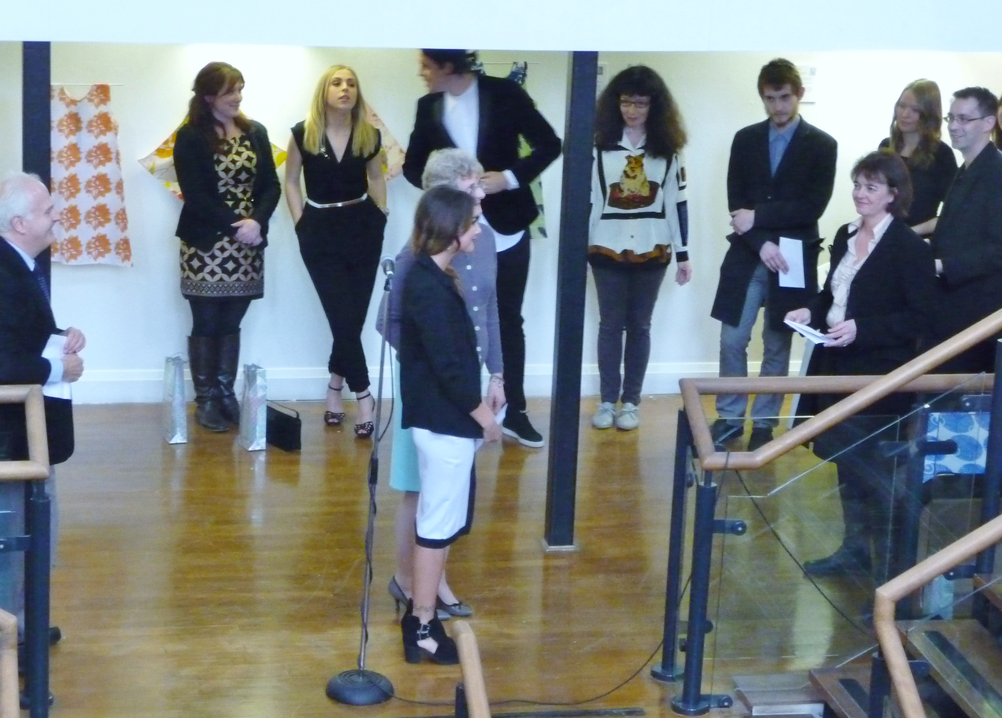 Kim Parkman presenting a prize to Chelsea Smith on behalf of Liverpool Women's Hospital at Liverpool Hope Univ Art Degree Show 2014