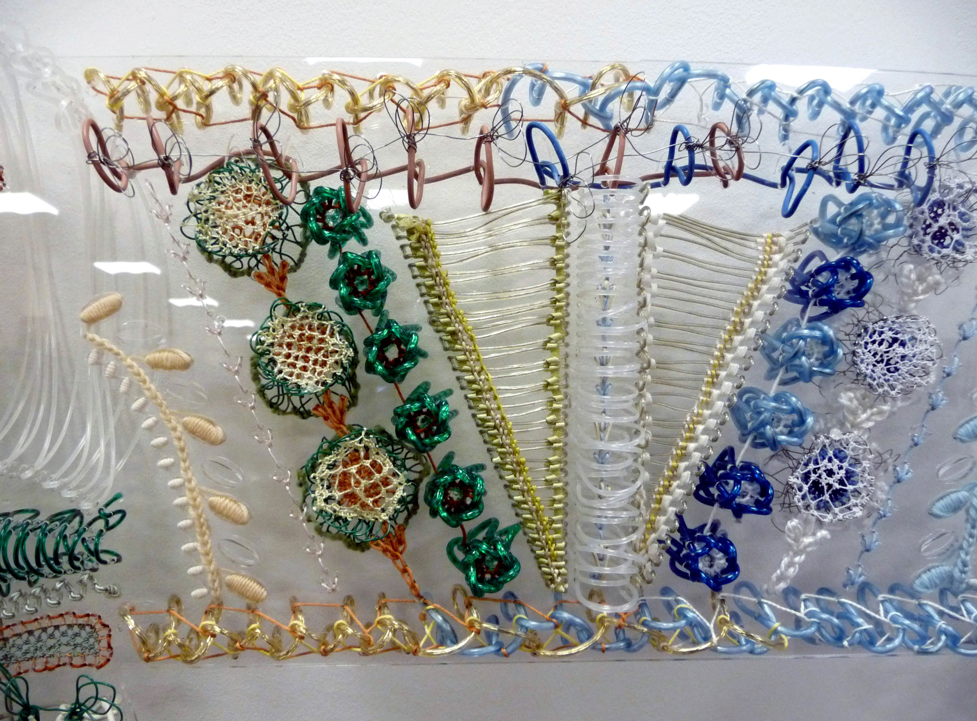 detail of SAMPLER 1 by Bella May Leonard, artist in residence at Gawthorpe Hall 2013. Stitch on pierced perspex.