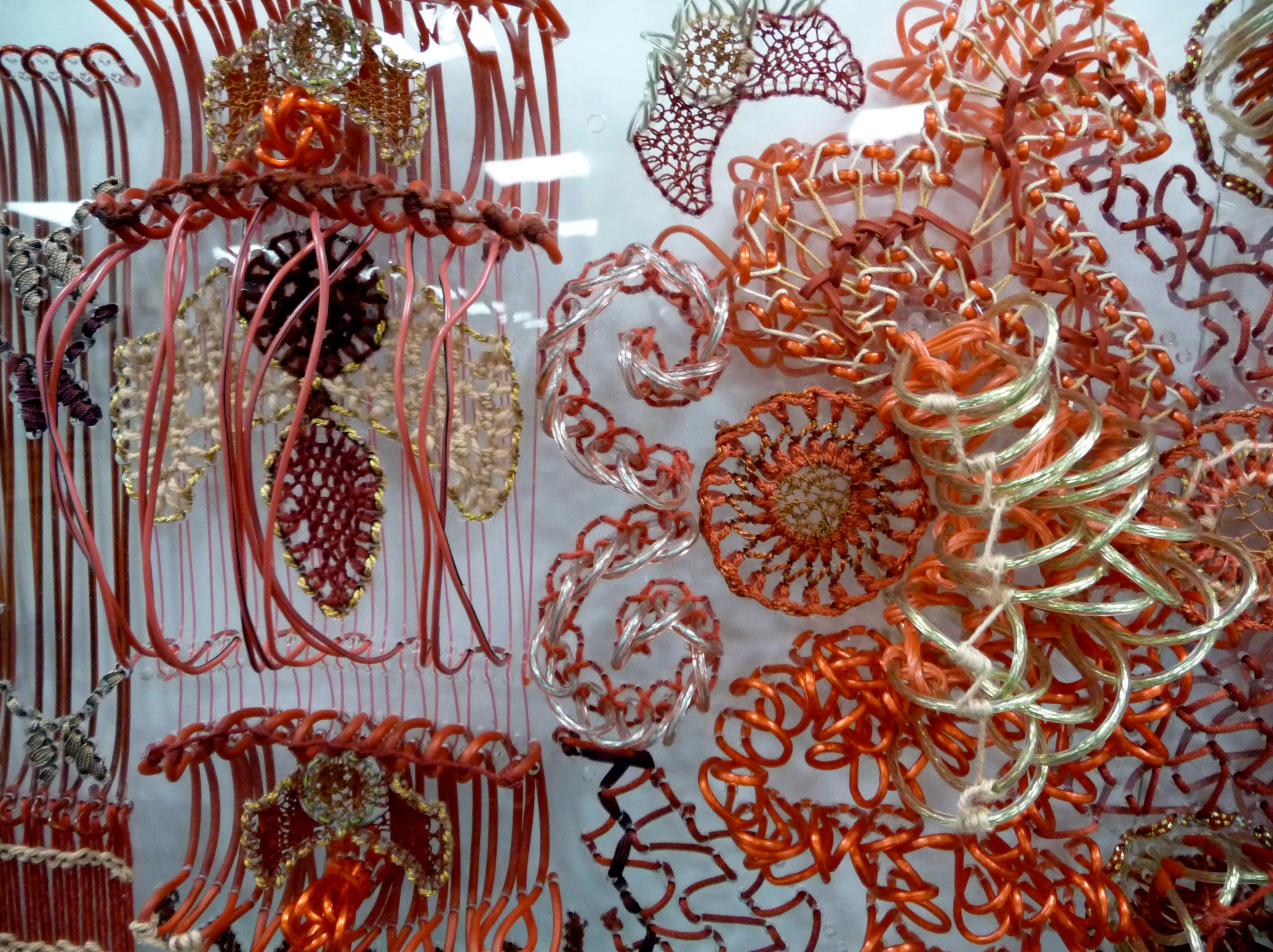detail of SAMPLED by Bella May Leonard, artist in residence at Gawthorpe Hall 2013. Stitch on pierced perspex.
