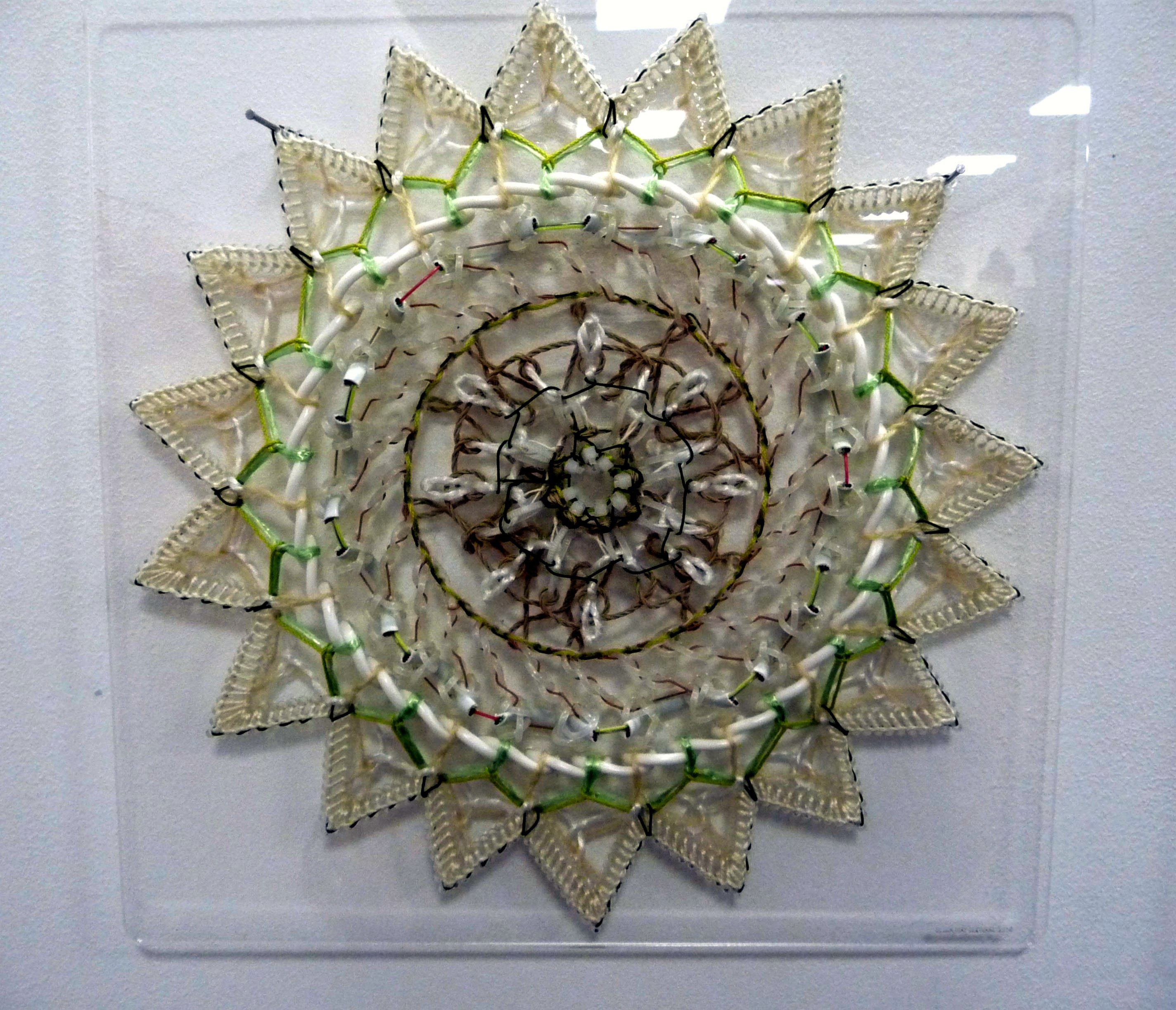 OFF THE TOP OF THEIR HEADS by Bella May Leonard, artist in residence at Gawthorpe Hall 2013. Stitch on pierced perspex.