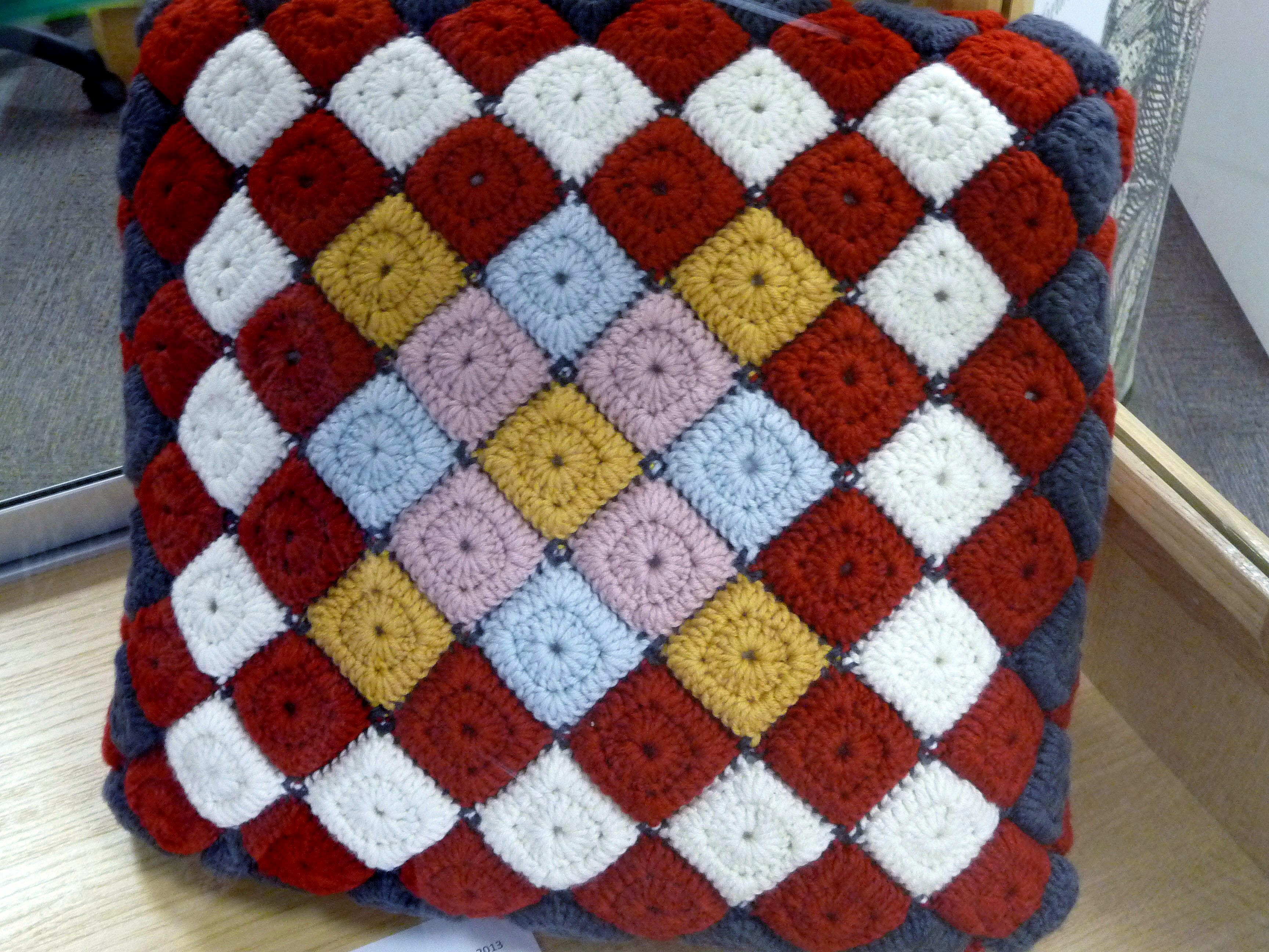 CROCHET CUSHION by Emma Varnam, inspired by a patchwork quilt in Gawthorpe Hall