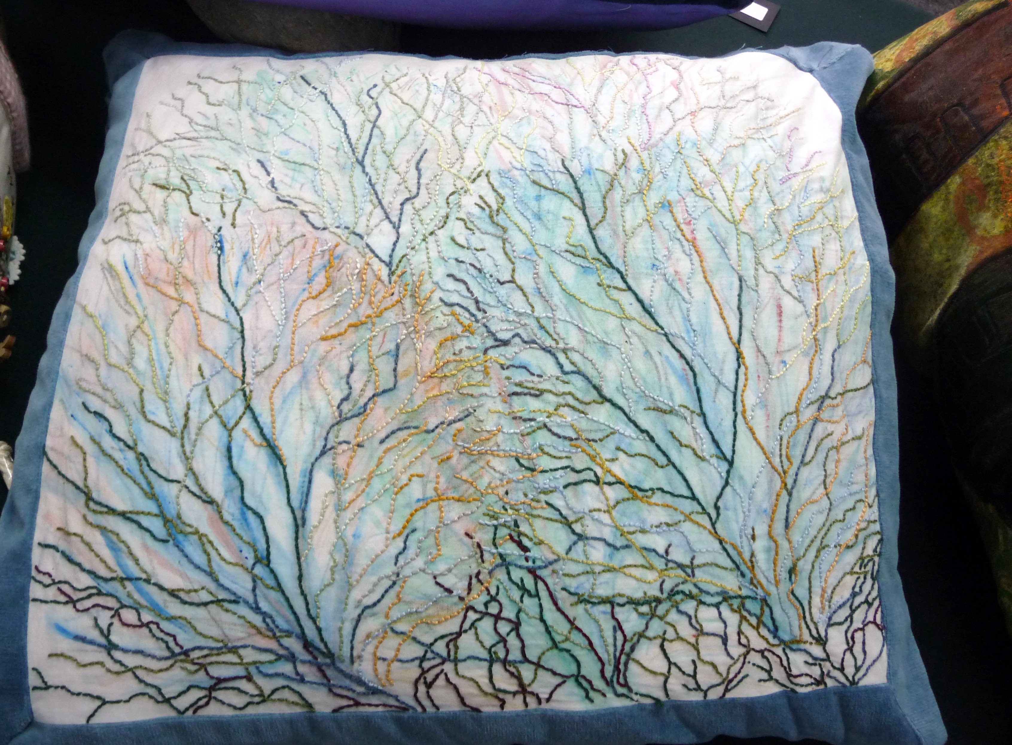 embroidered cushion by Sue Tressider