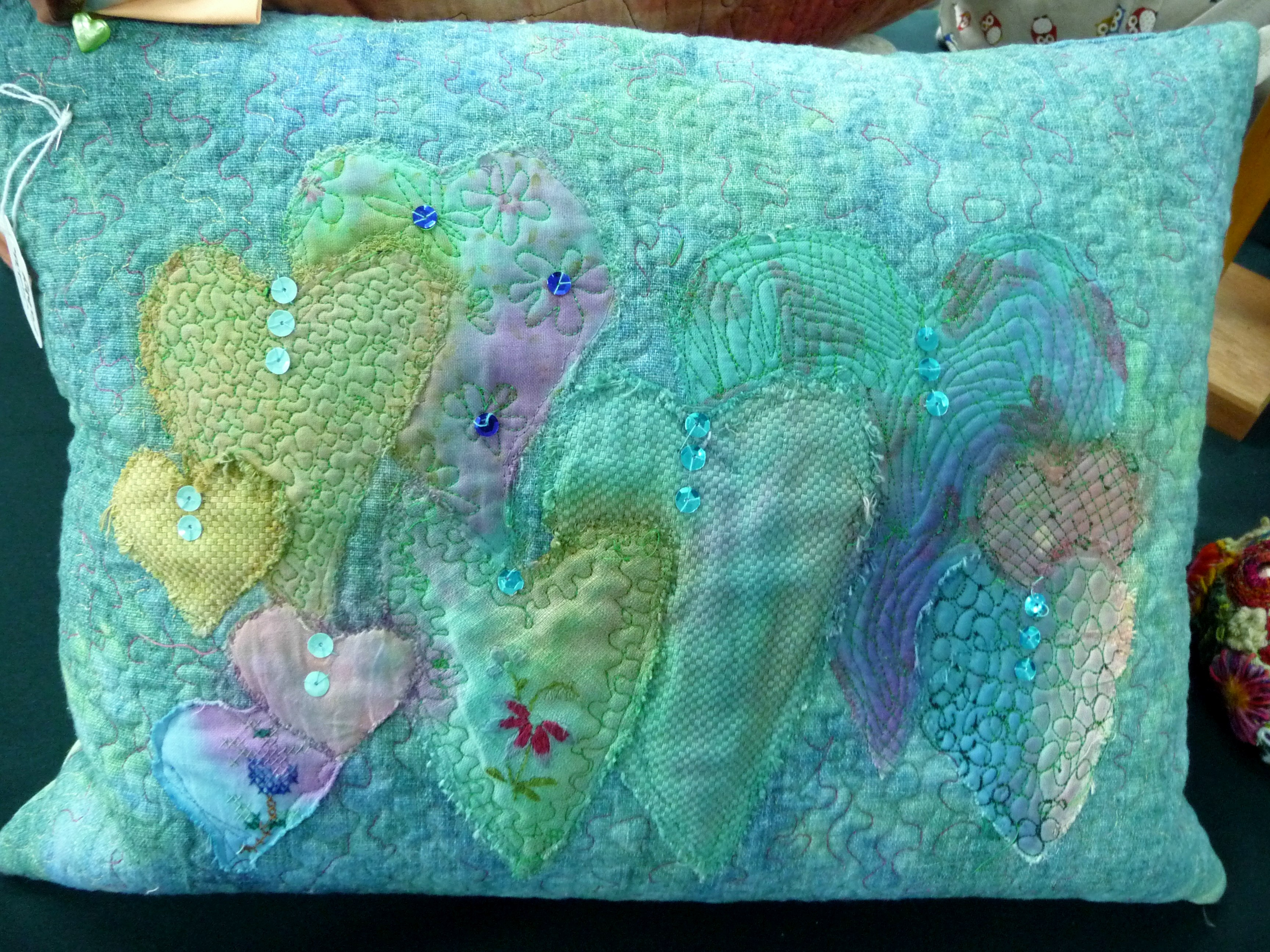 embroidered cushion by Judith Fabby