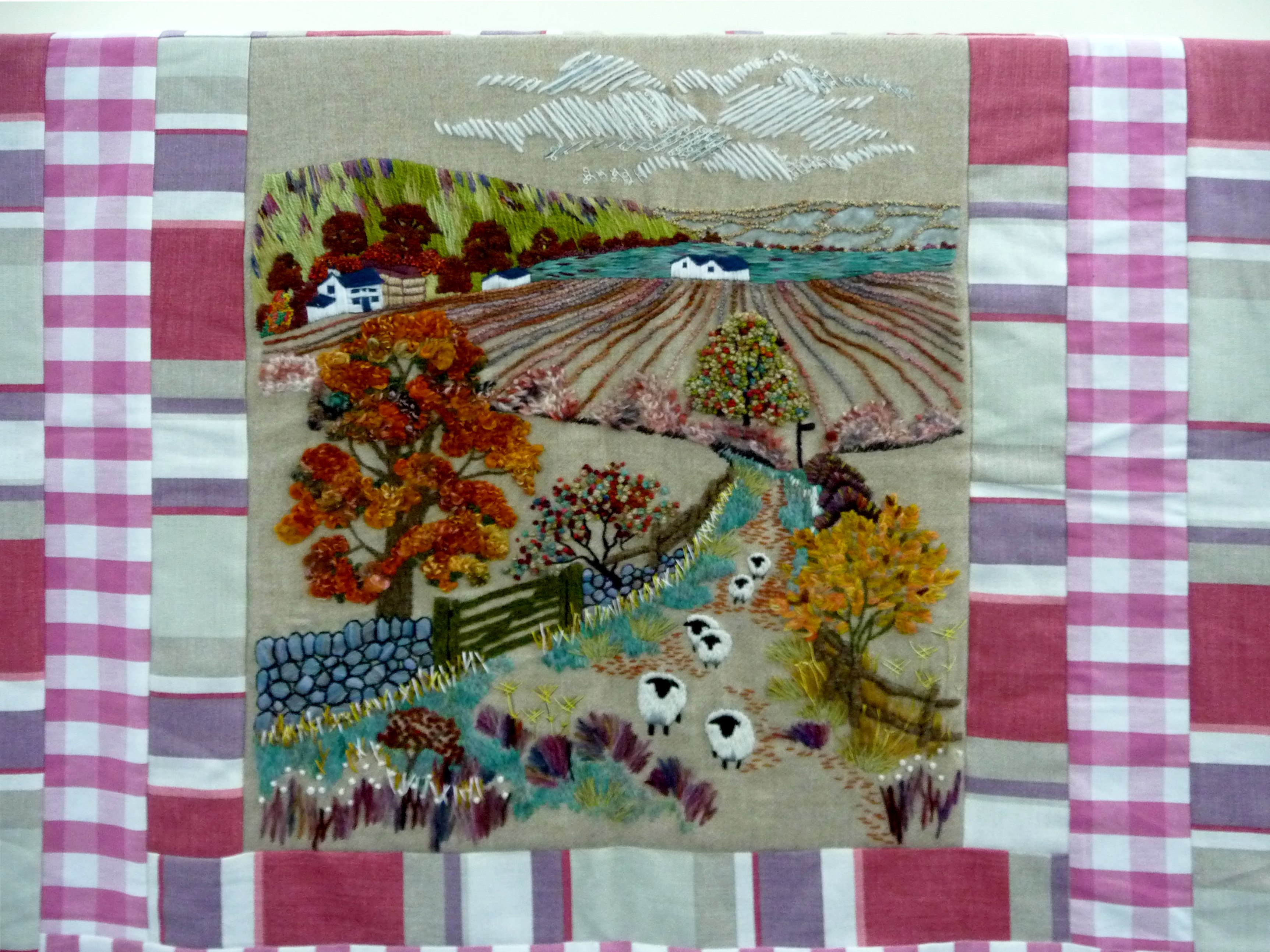 detail of embroidered quilt by a student of Neston Community Centre