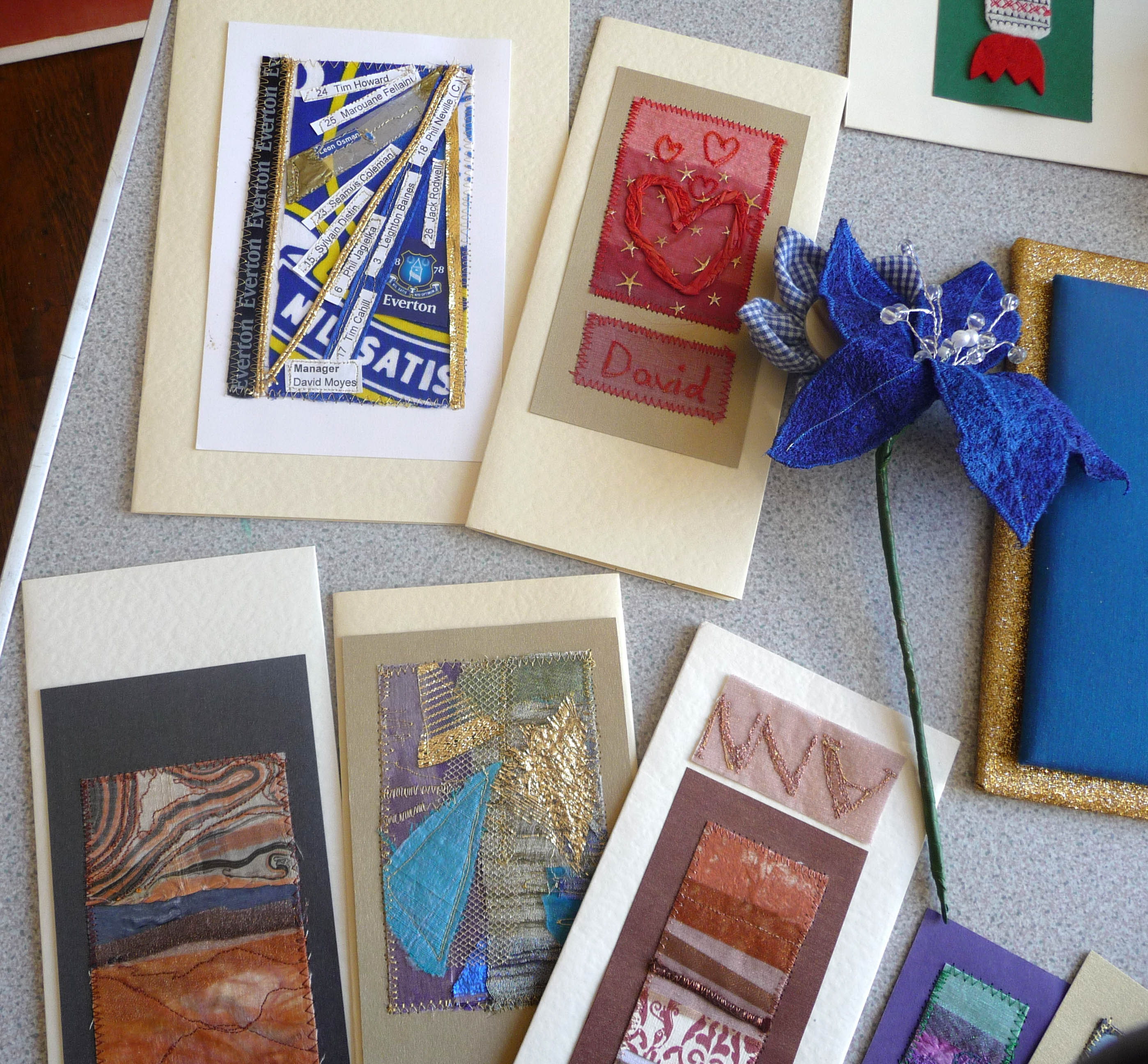 slide showing embroidered cards by Marie Stacey