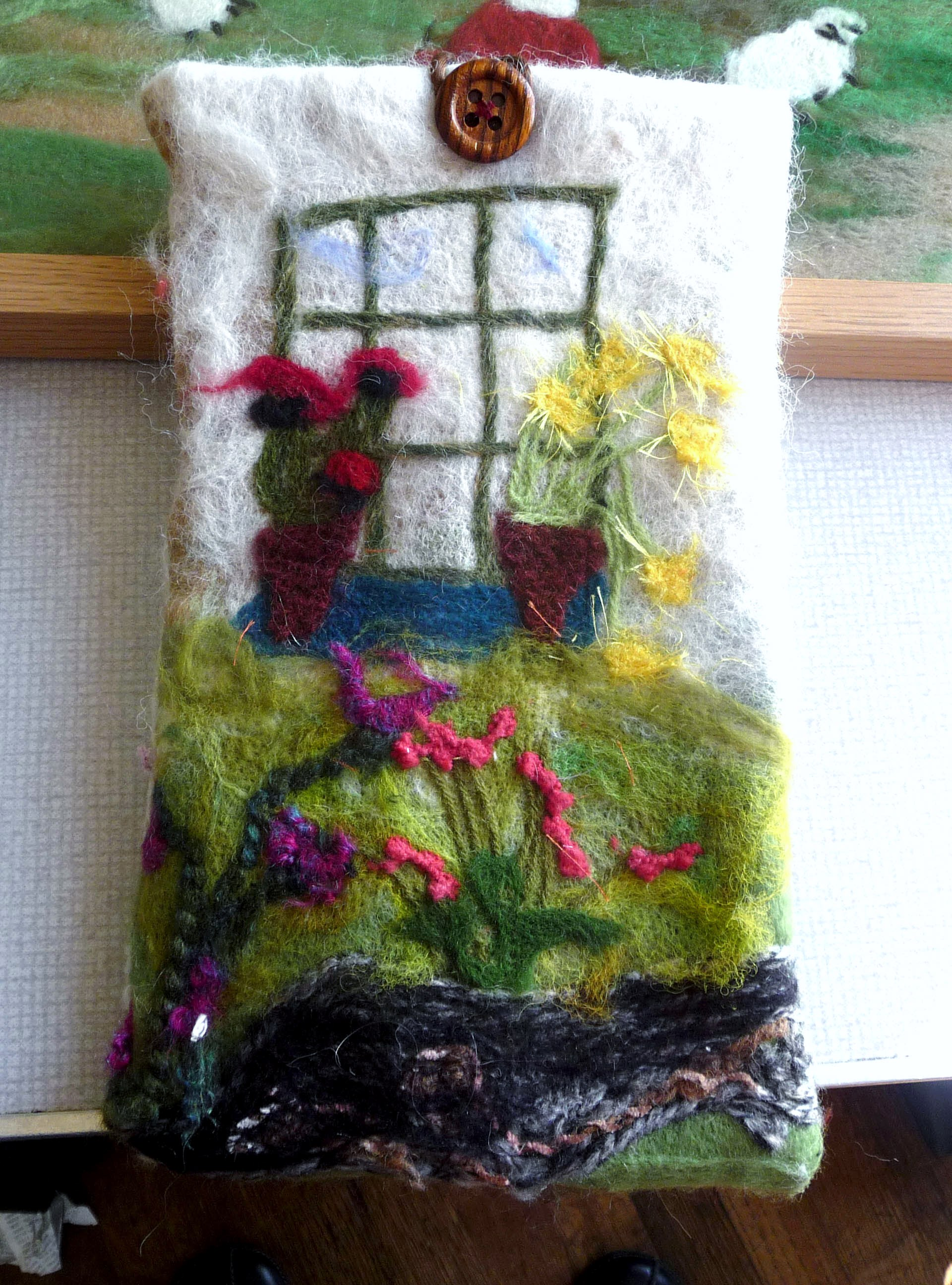 tablet case needlefelted  by a member of Wirral Society of the Blind and Partially Sighted