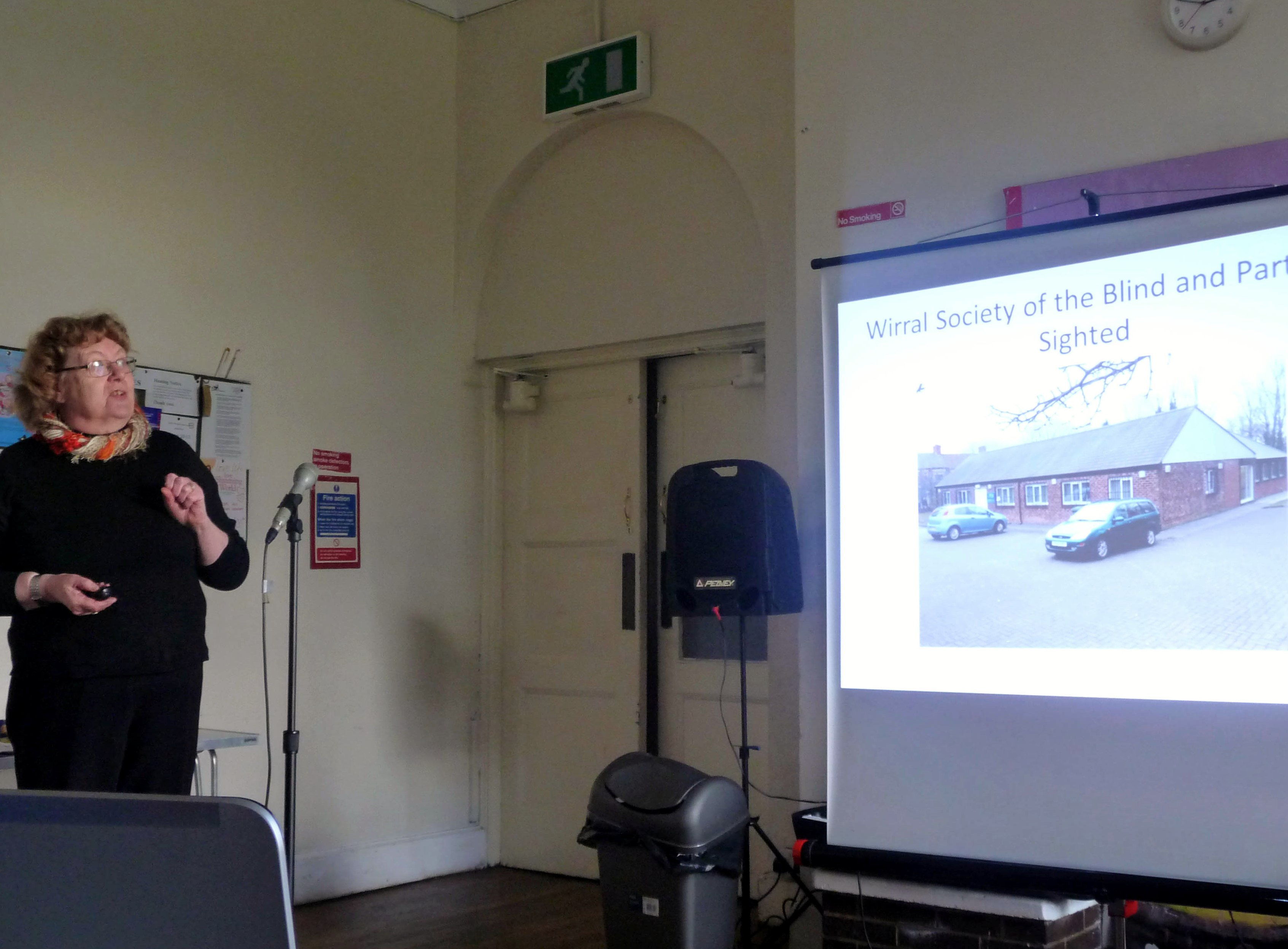 Terri Holmes from Wirral Society of the Blind and Partially Sighted speaking to Merseyside Embroiderers Guild members