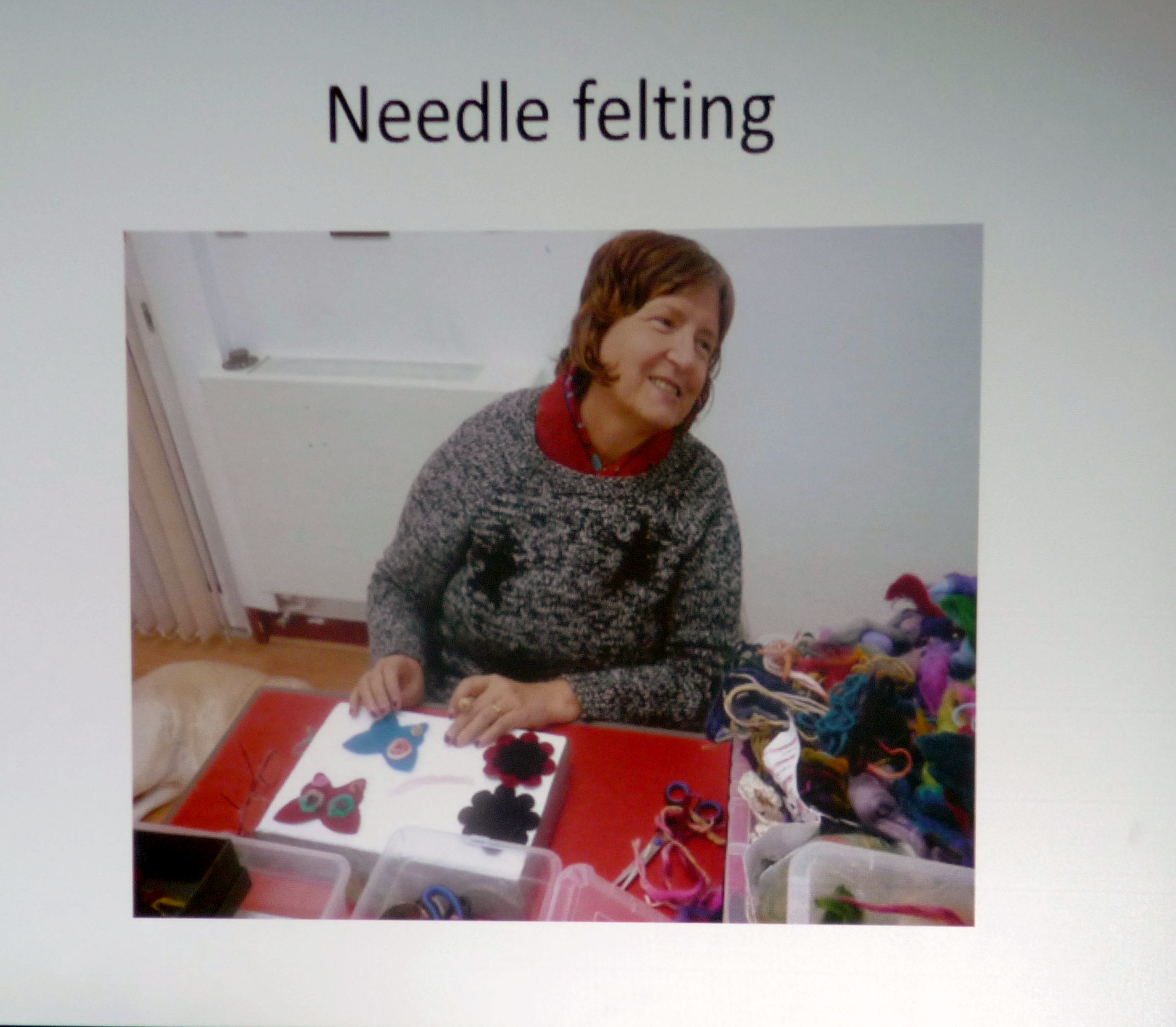 slide showing a member of Wirral Society of the Blind and Partially Sighted needlefelting
