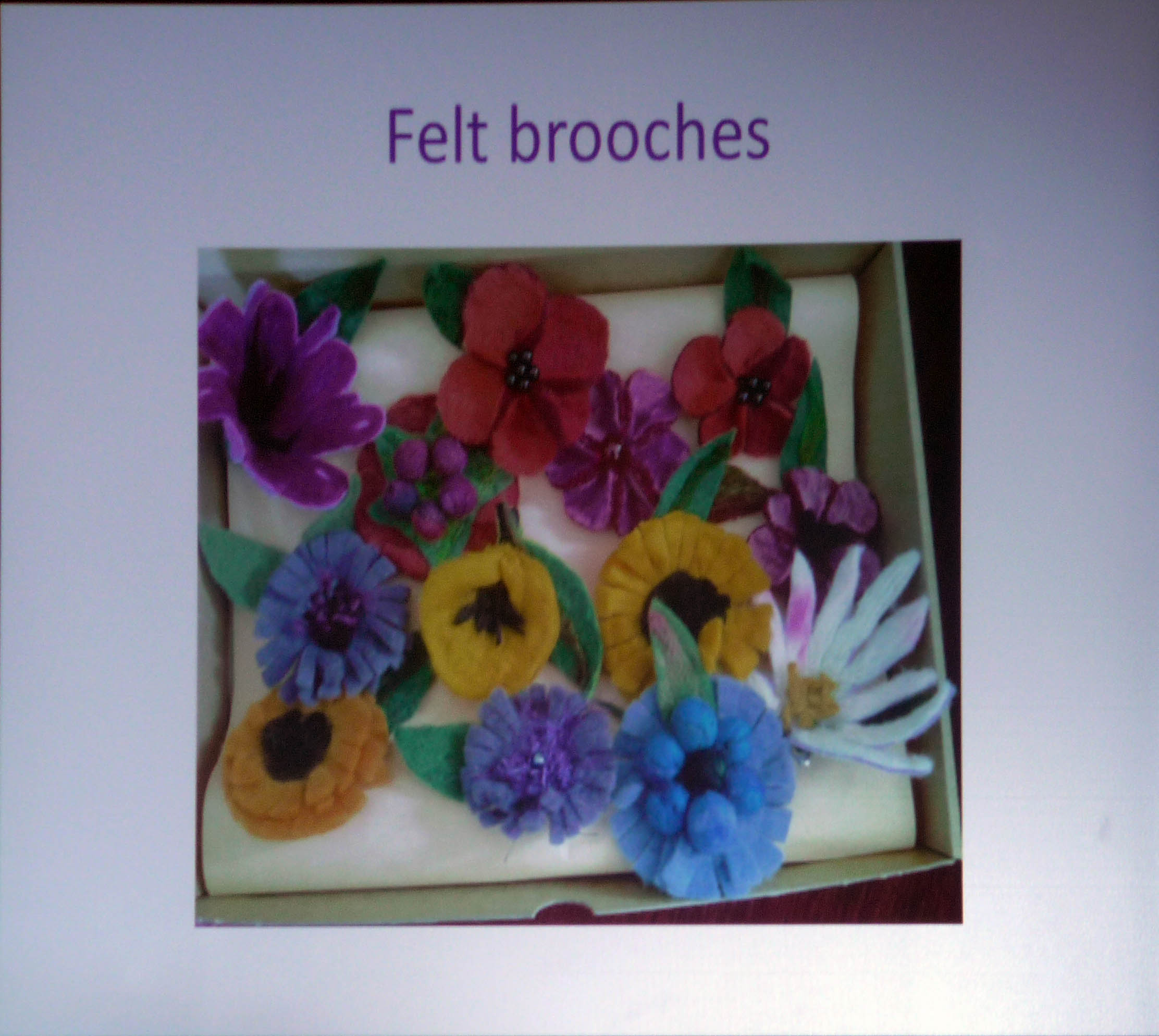 slide showing felt brooches made by members of Wirral Society of the Blind and Partially Sighted