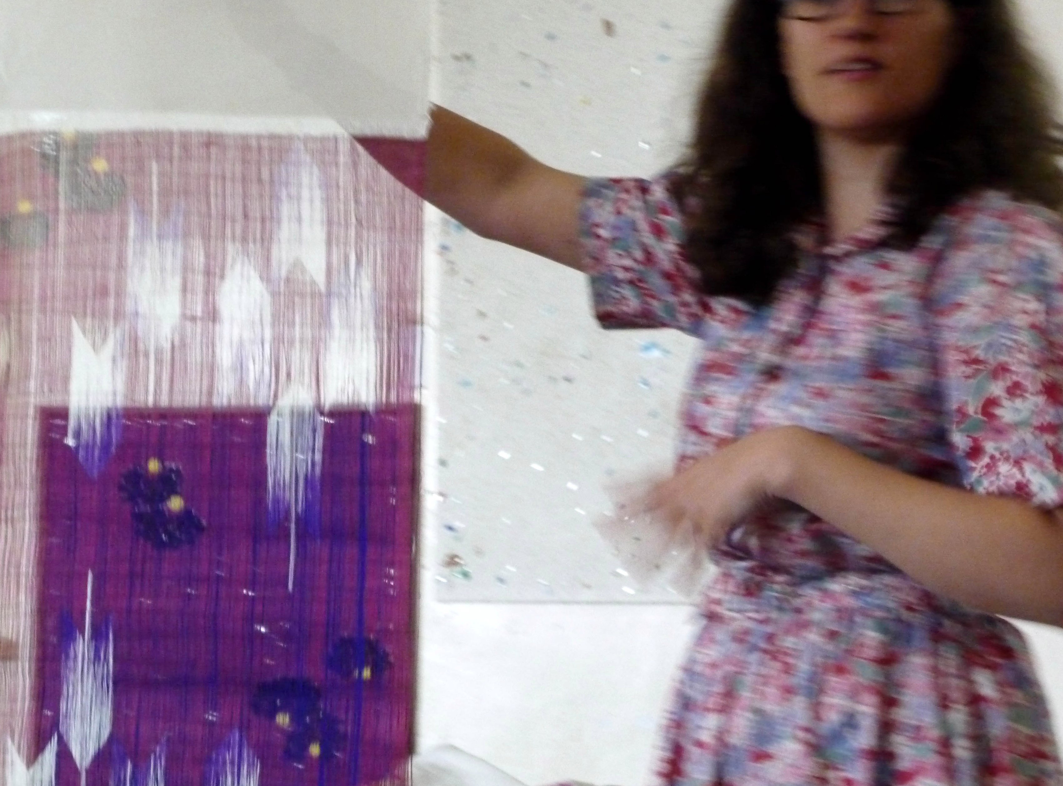 Katie Chaplin showing us fabric that she screen printed only on warp threads