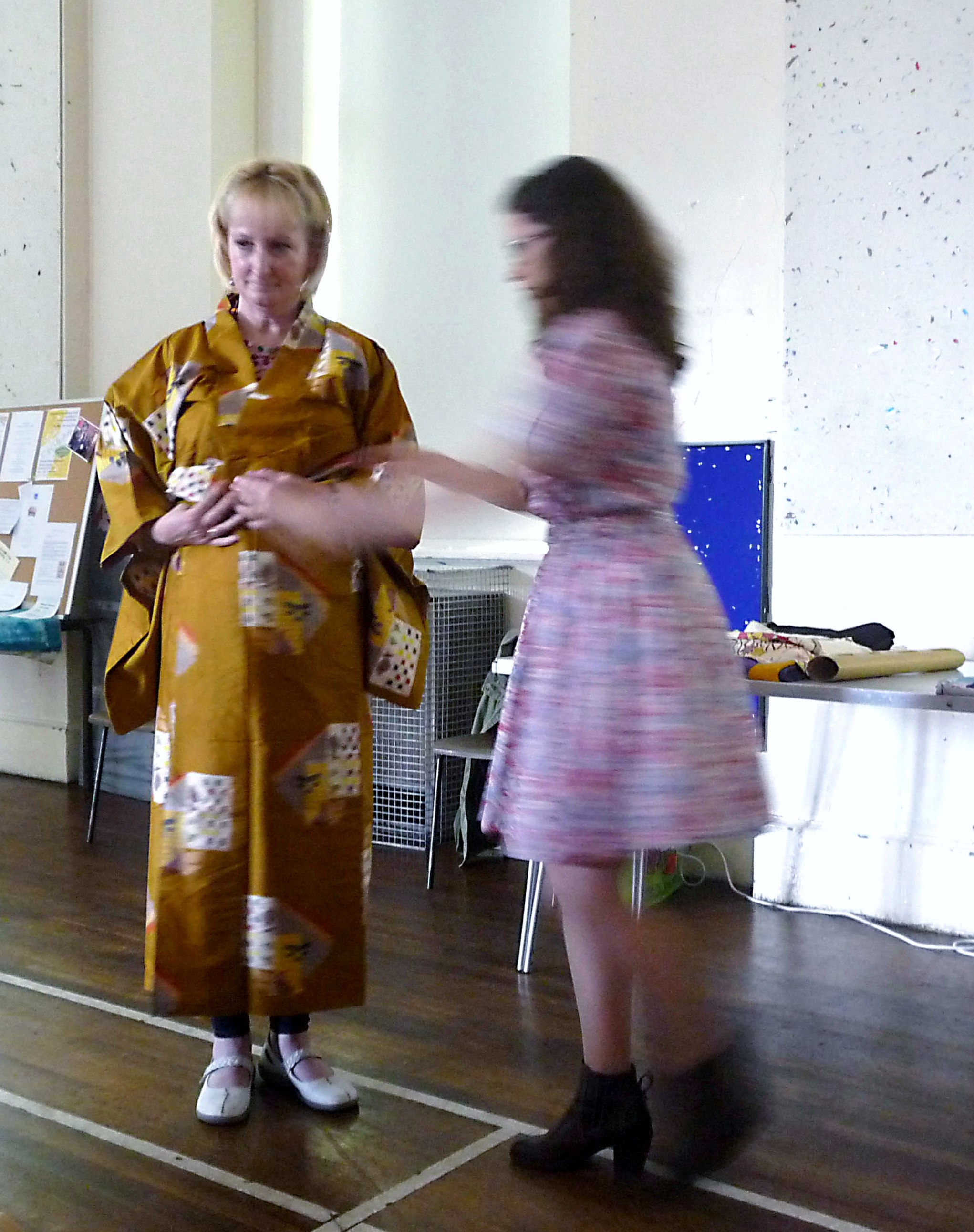 Sarah Lowes modelling a kimono assisted by Katie Chaplin