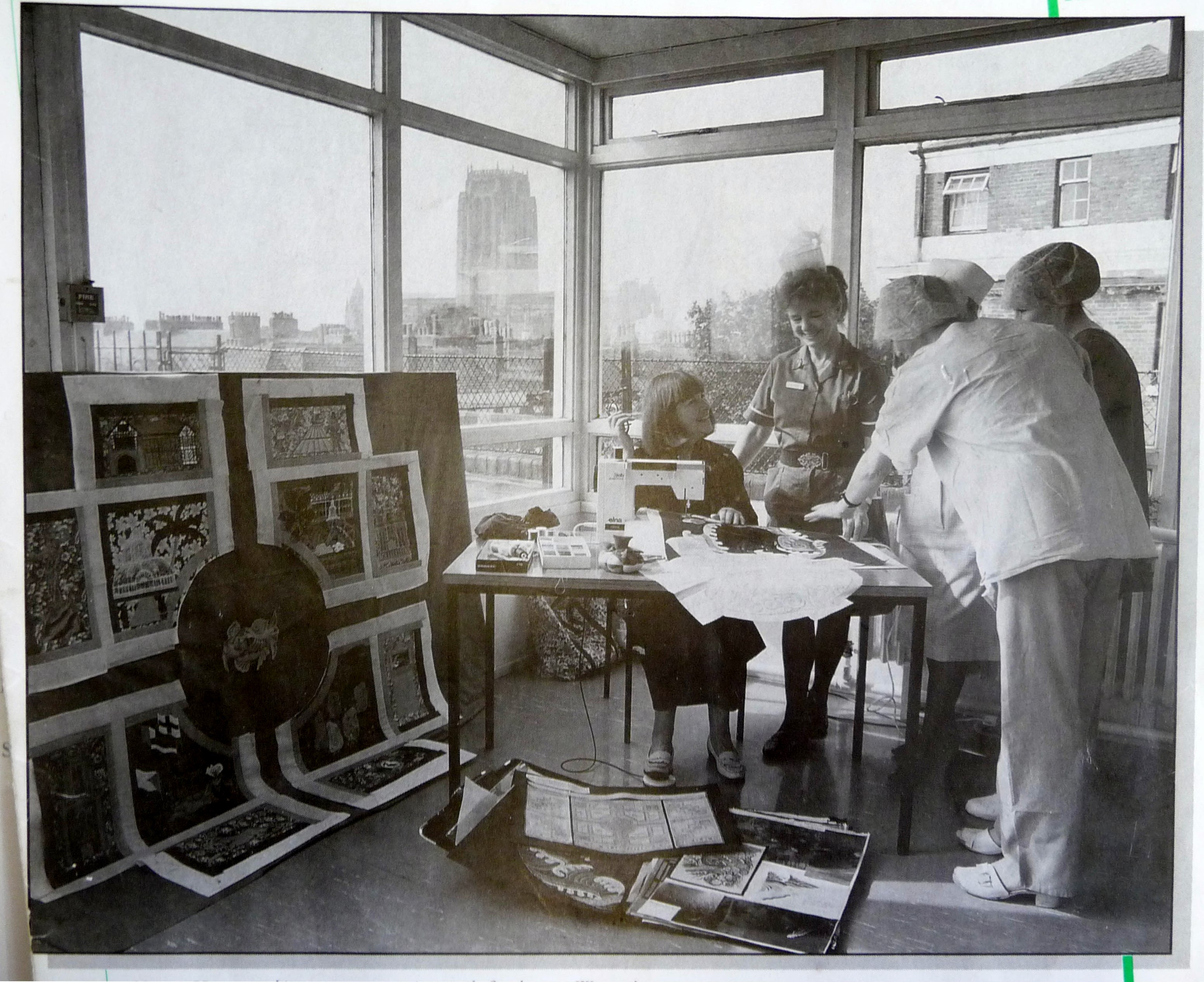 1995 newspaper picture of Norma Heron working on THE POOL OF LIFE embroidered hanging in Womens Hospital, Liverpool