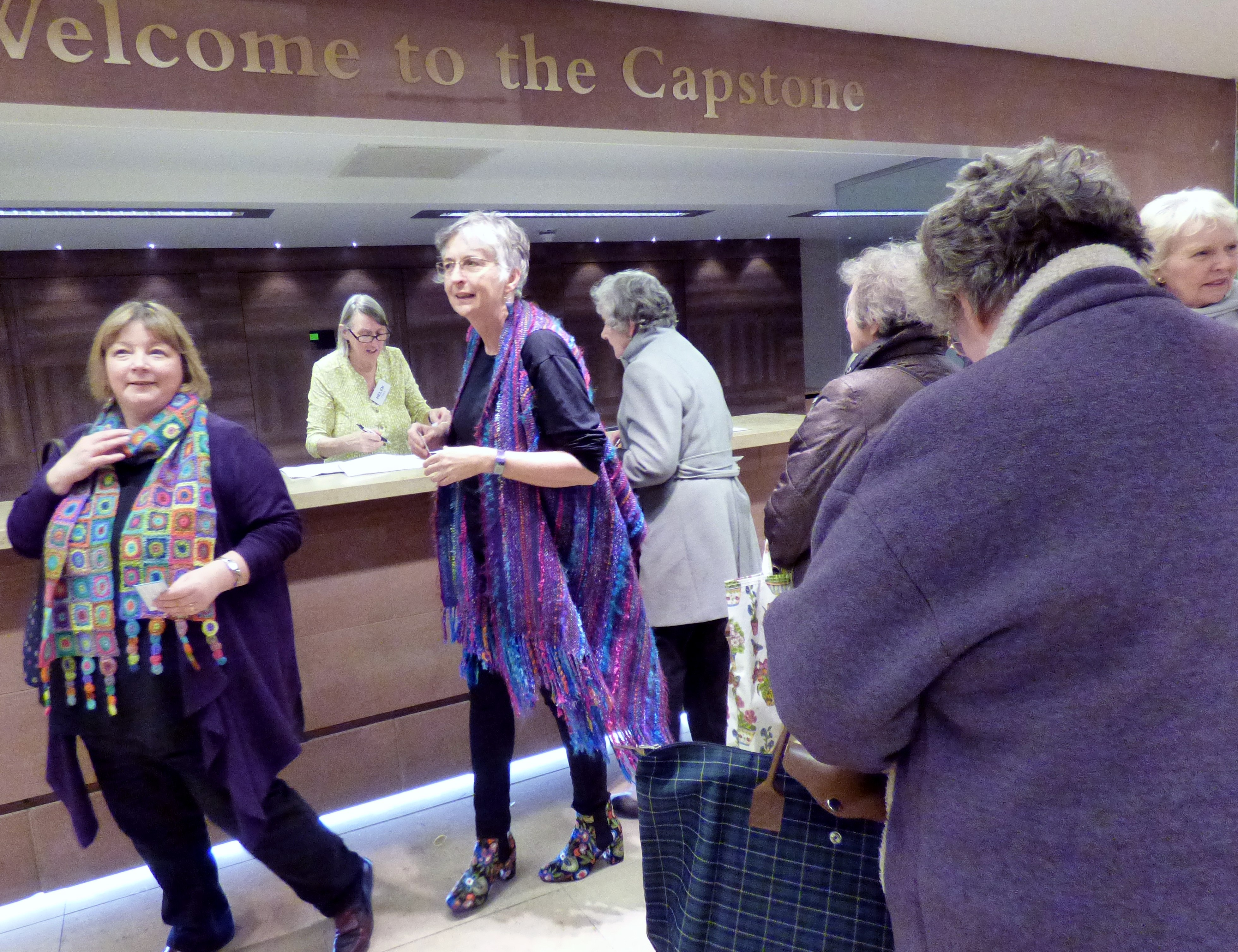 Helen is welcoming our visitors at Kaffe Fassett Lecture, Capstone Theatre, Dec 2016
